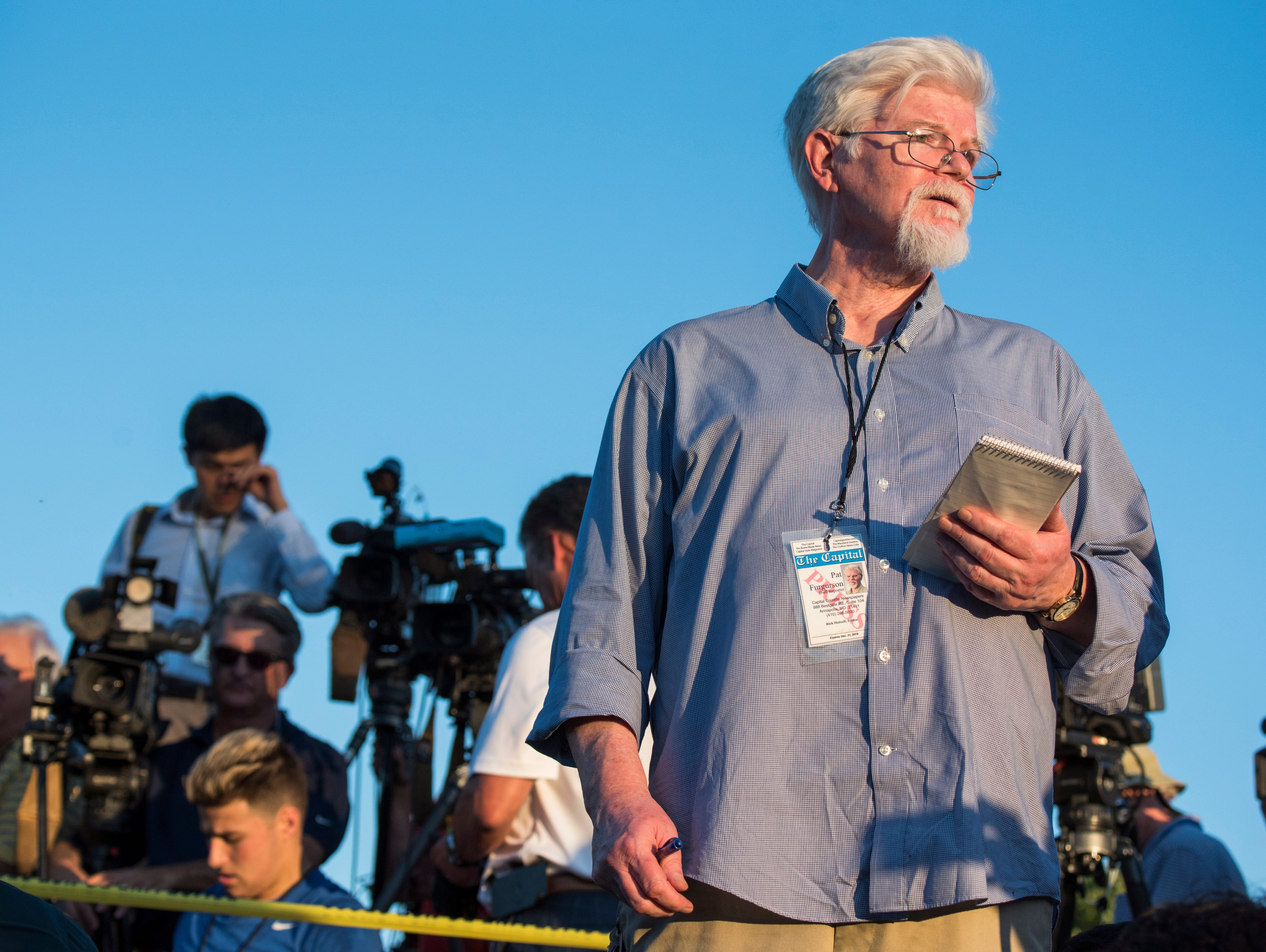 June 28, 2018: Pat Furgurson, staff reporter of the Capital Gazette, reports outside the scene of a shooting at the Capital Gazette building in Annapolis, Md. Five newspaper employees were killed and several injured in the shooting.