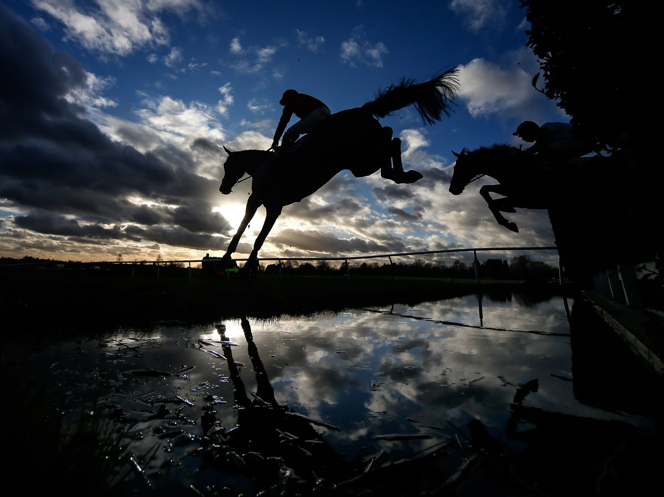 Jan. 31, 2018: A runner clears the water jump at Leicester Racecourse in Leicester, England.