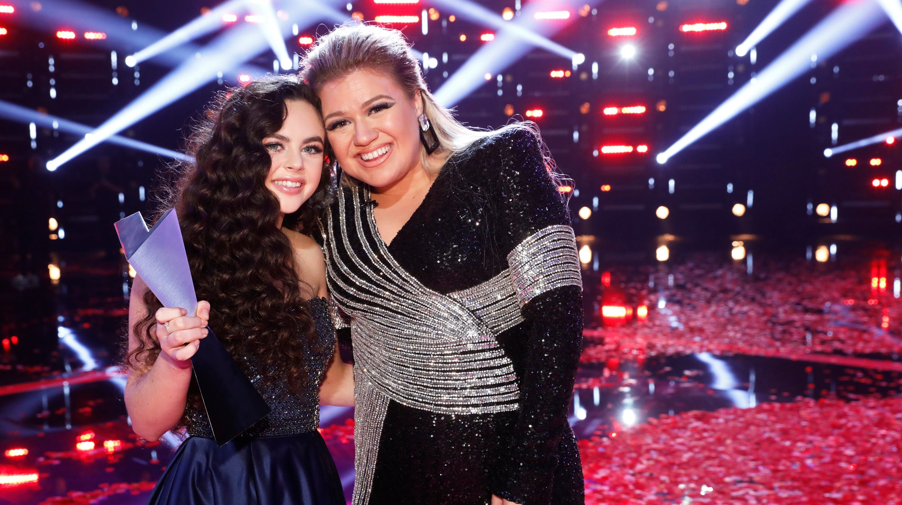 Chevel Shepherd, left, and her coach, Kelly Clarkson, stand on the confetti-covered stage of 'The Voice' minutes after Shepherd was named the Season 15 champion.
