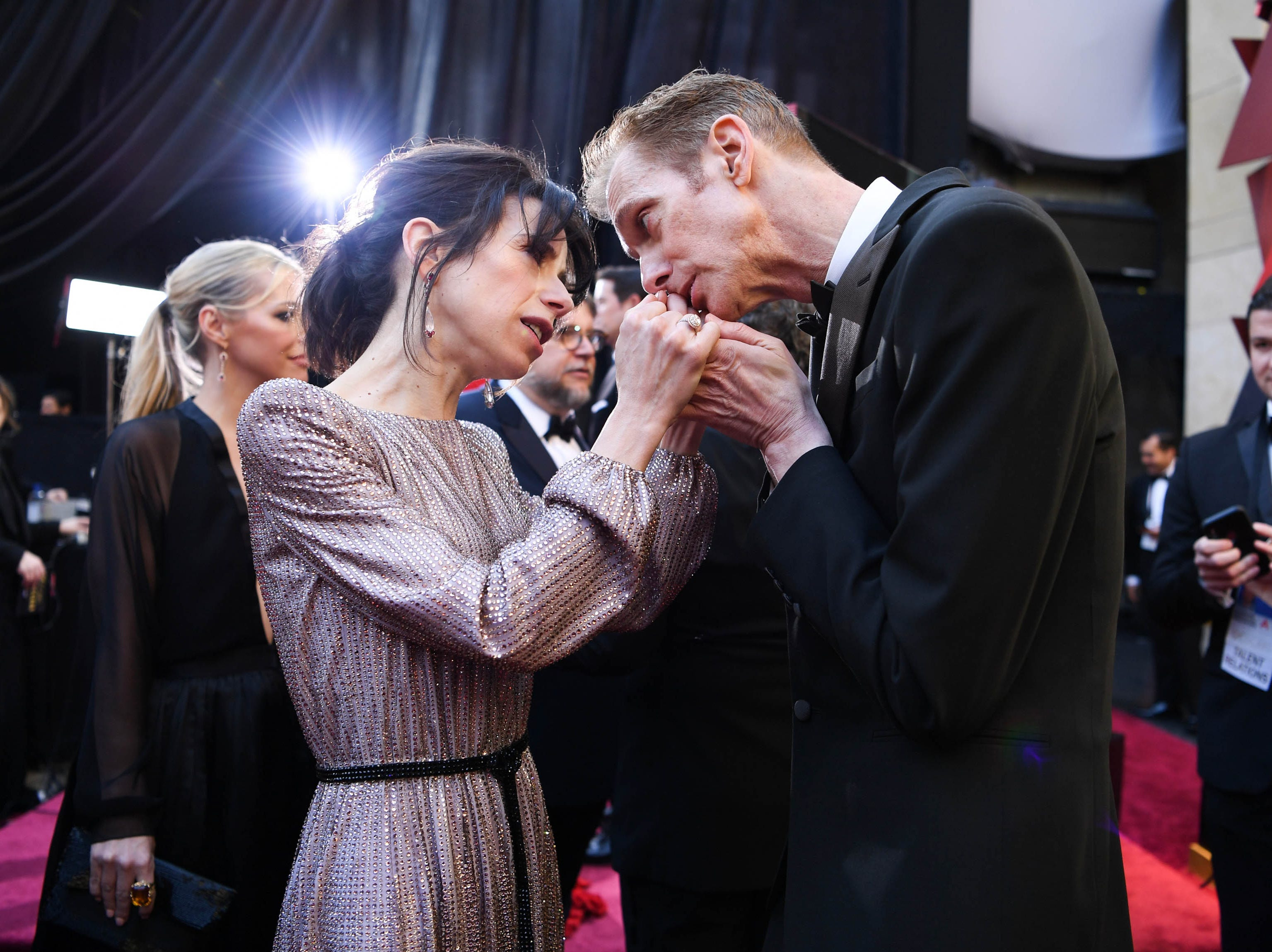 March 4, 2018: Sally Hawkins and Doug Jones share a moment on the red carpet at the 90th Academy Awards.
