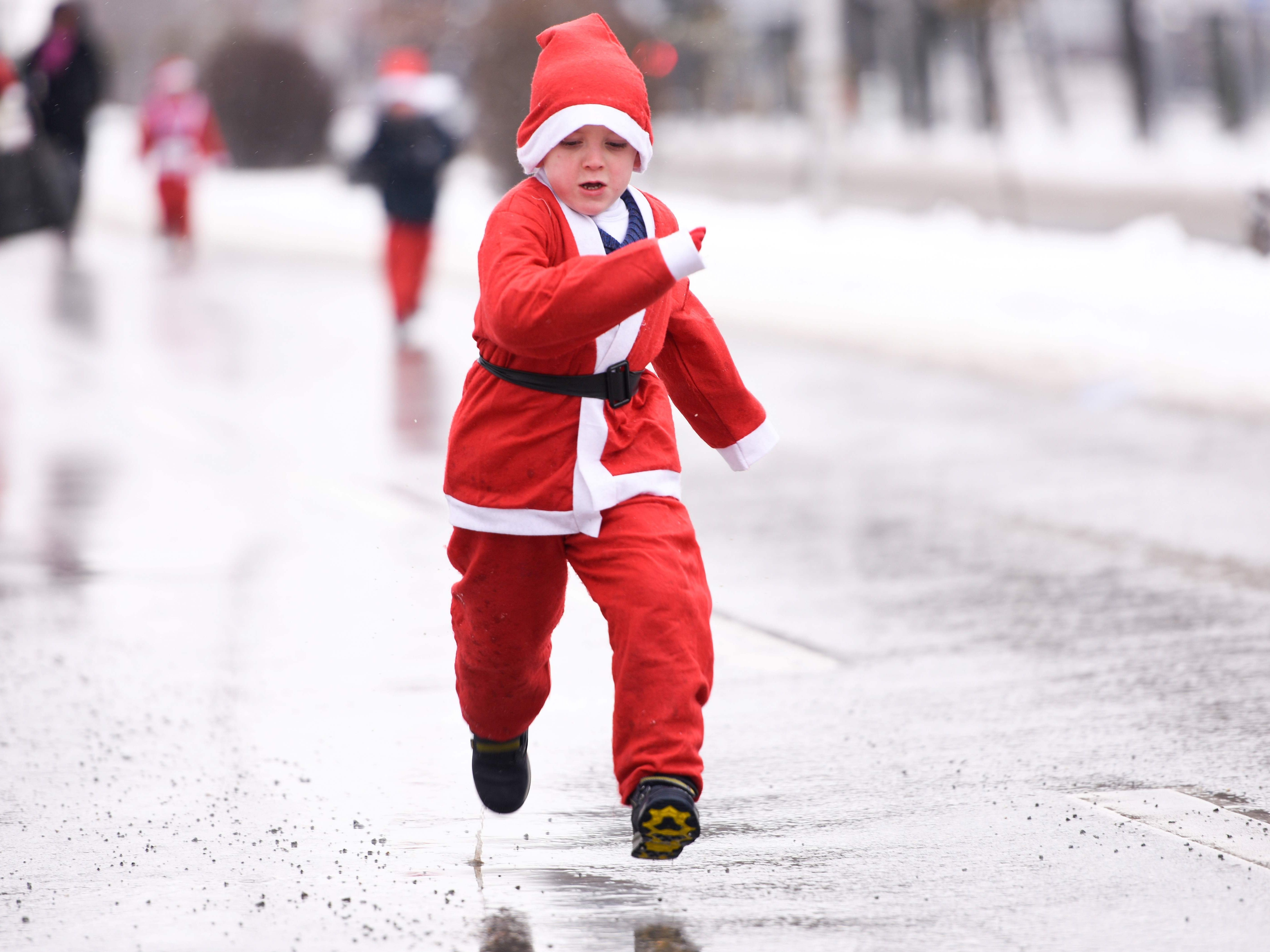 A child dressed as Santa Claus takes part in a charity race in Pristina, Kosovo on Dec. 16, 2018, to raise funds for families in need in Kosovo.