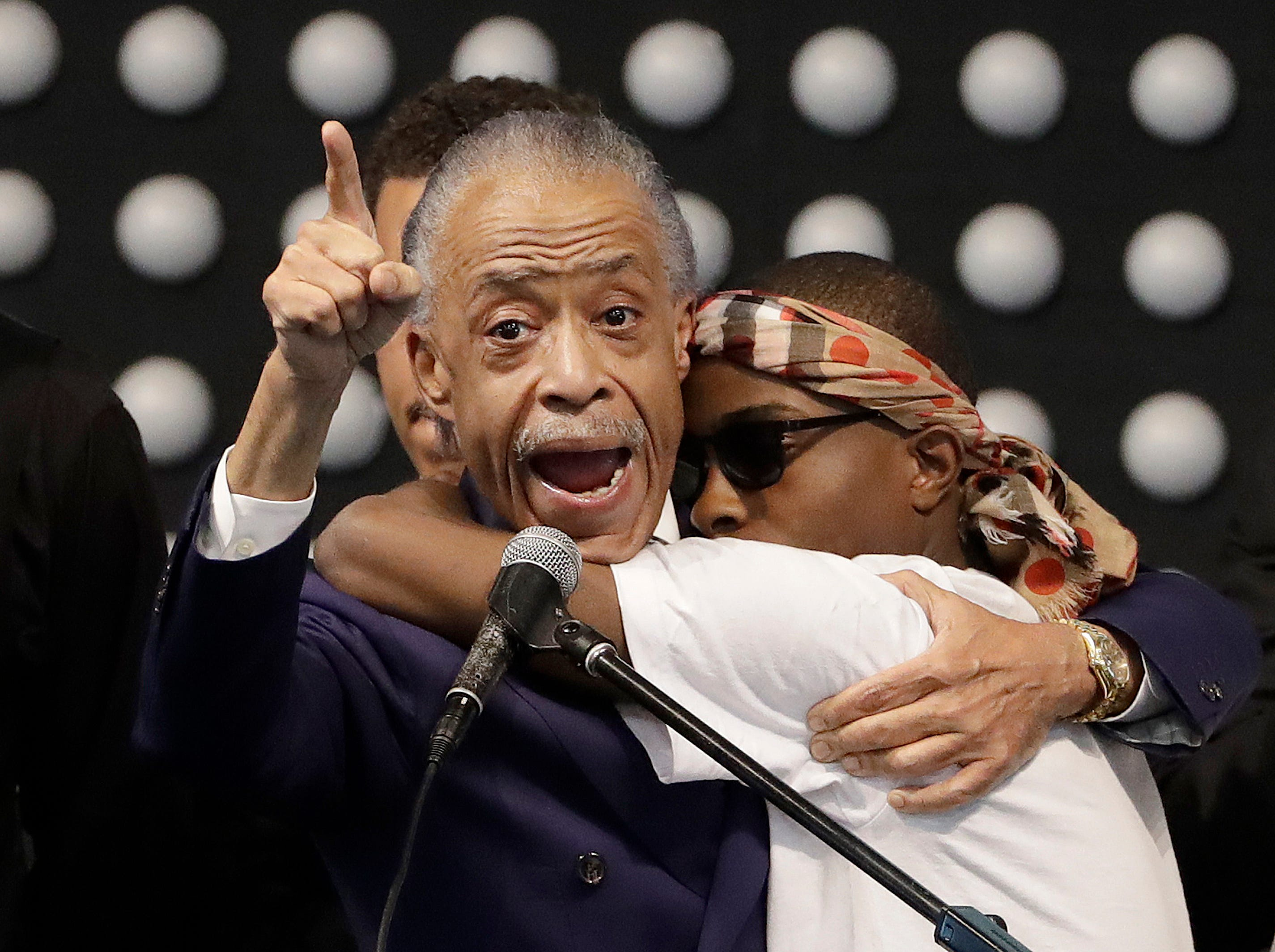 March 29, 2018: Rev. Al Sharpton, left, hugs Stevante Clark while speaking during the funeral services for police shooting victim Stephon Clark at Bayside Of South Sacramento Church in Sacramento, Calif. Clark, who was unarmed, was shot and killed by Sacramento Police Officers.
