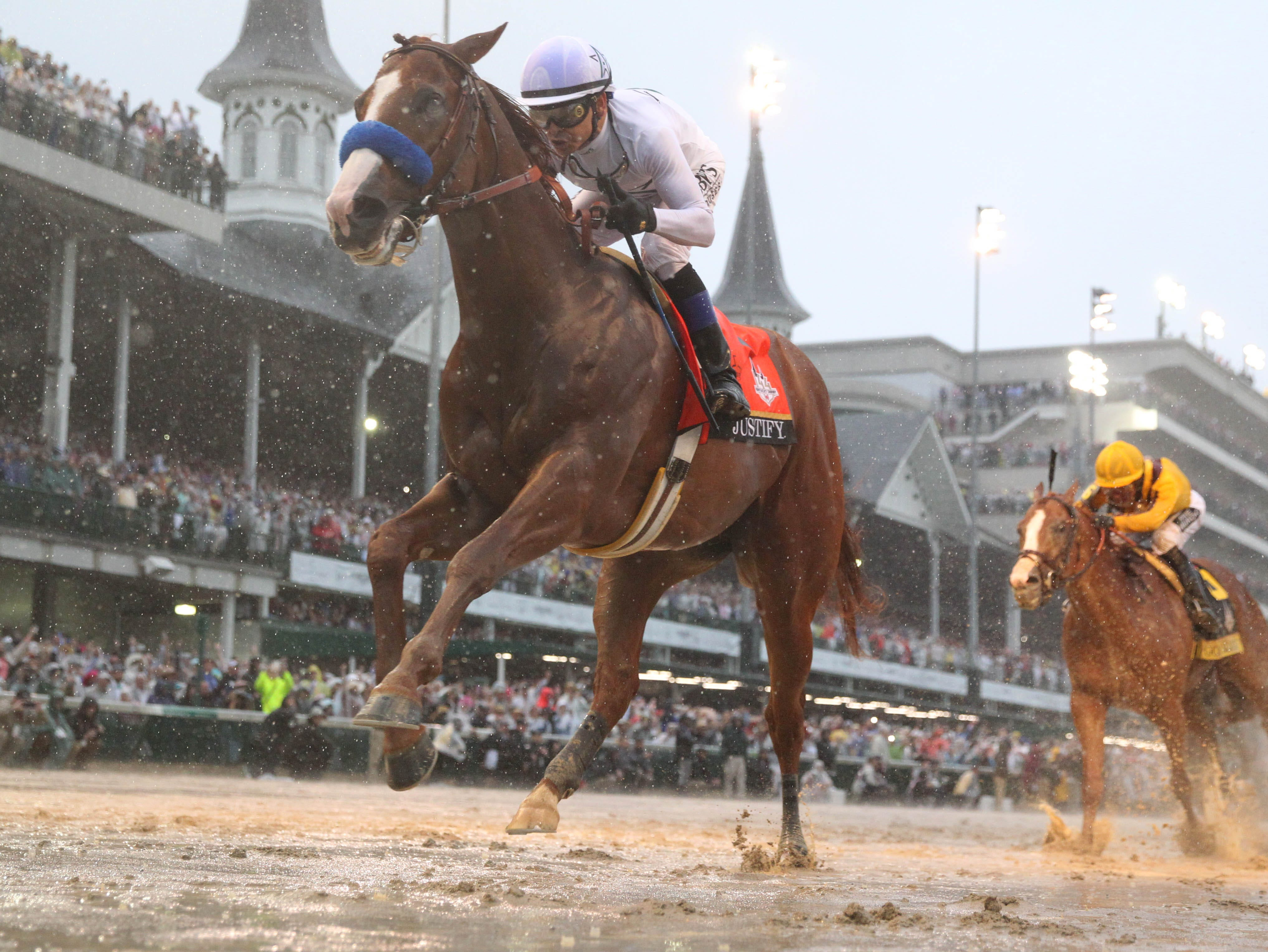 May 5, 2018: Mike Smith aboard Justify (7) crosses the finish line to win the 144th running of the Kentucky Derby at Churchill Downs.