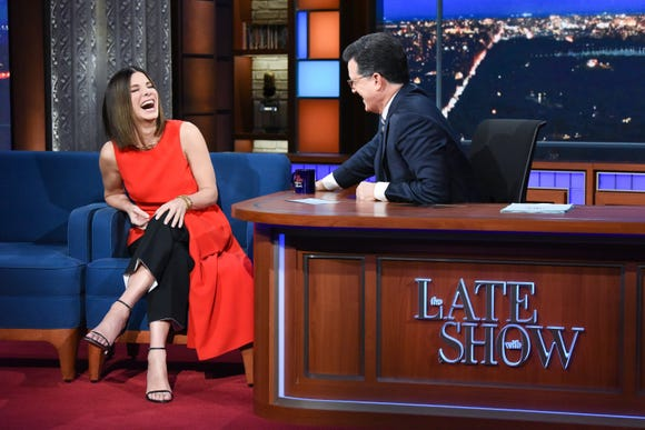 """I ate it several times,"" Bullock told Colbert, recounting what it was like to spend most of the ""Bird Box"" shoot blindfolded."