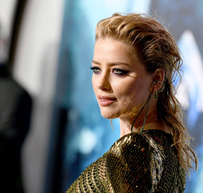 """Amber Heard at the premiere of """"Aquaman"""" in which she stars, on Dec. 12, 2018 in Los Angeles."""