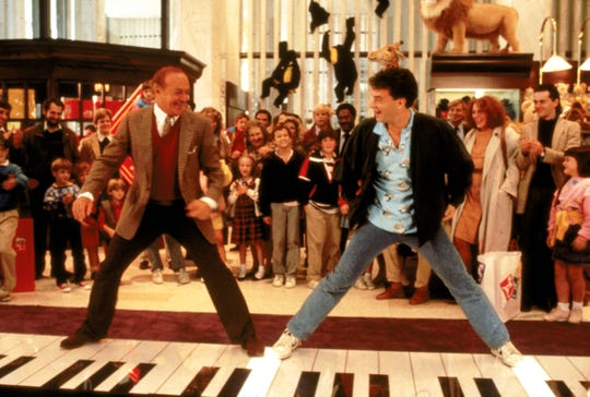 """The 1988 comedy 'Big"""" made Marshall the first female director to helm a movie that grossed more than $100 million at the box office. Here, Robert Loggia, left, and Tom Hanks dance during the famous piano scene at FAO Schwartz. Hanks' role as a boy in the body of a grown man netted him his first Oscar nomination."""