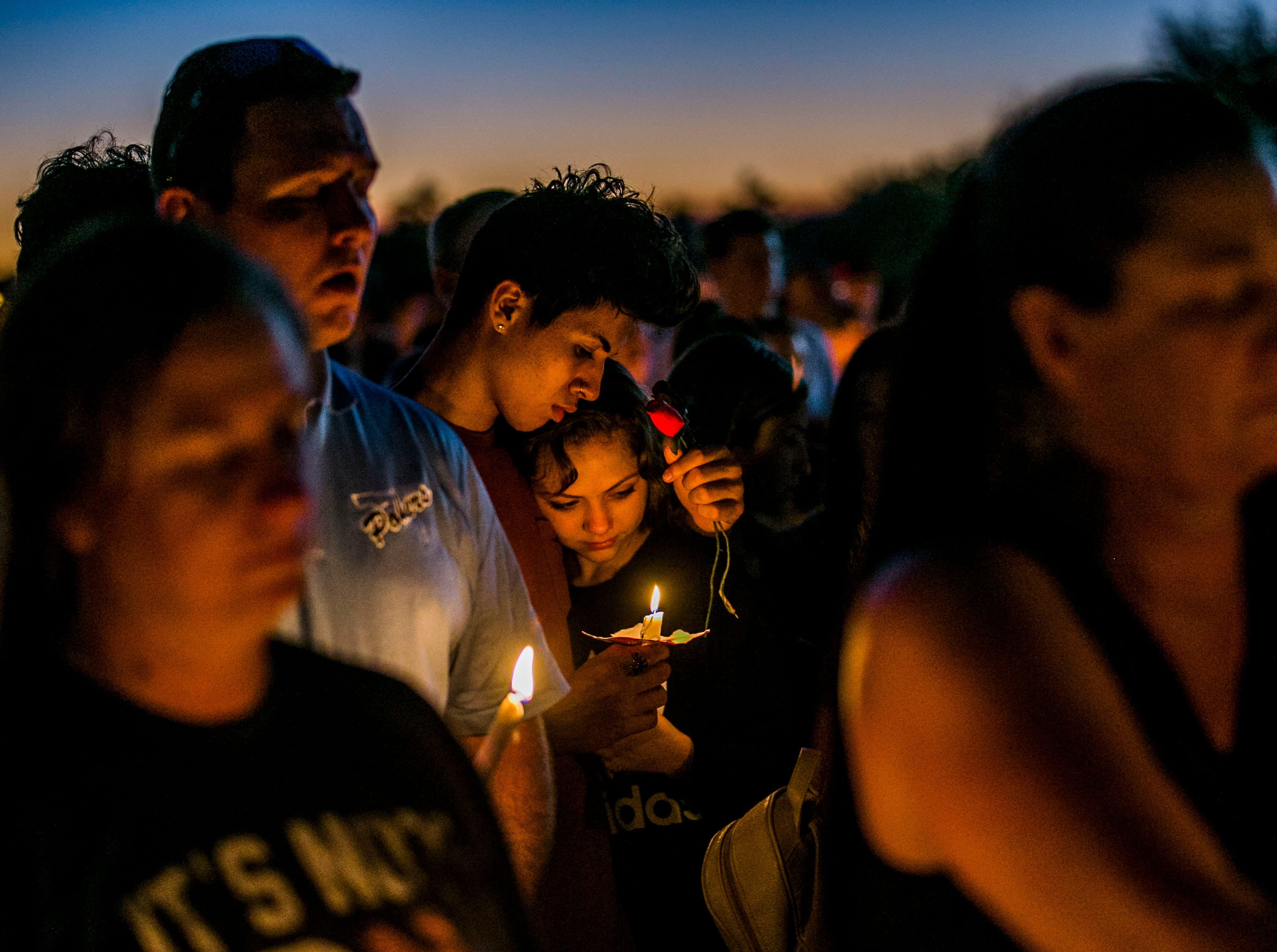 Feb. 15, 2018: People mourn together during a candlelight vigil at Pine Trails Park in Parkland, Fla. after a shooting at Marjory Stoneman Douglas High School in Parkland, Fla. on Wednesday that took 17 lives.