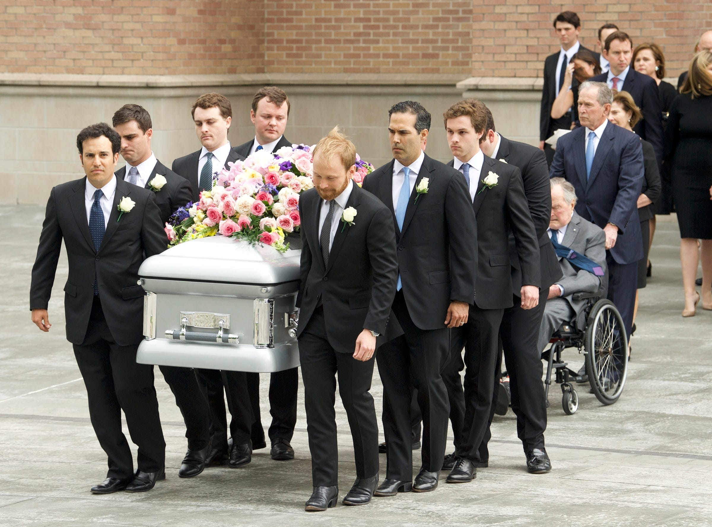 April 21, 2018: Former First Lady Barbara Bush's casket is carried from St. Martin's Episcopal Church by her grandsons. Her husband, former President George H.W. Bush, and son, former President George W. Bush, follow behind.