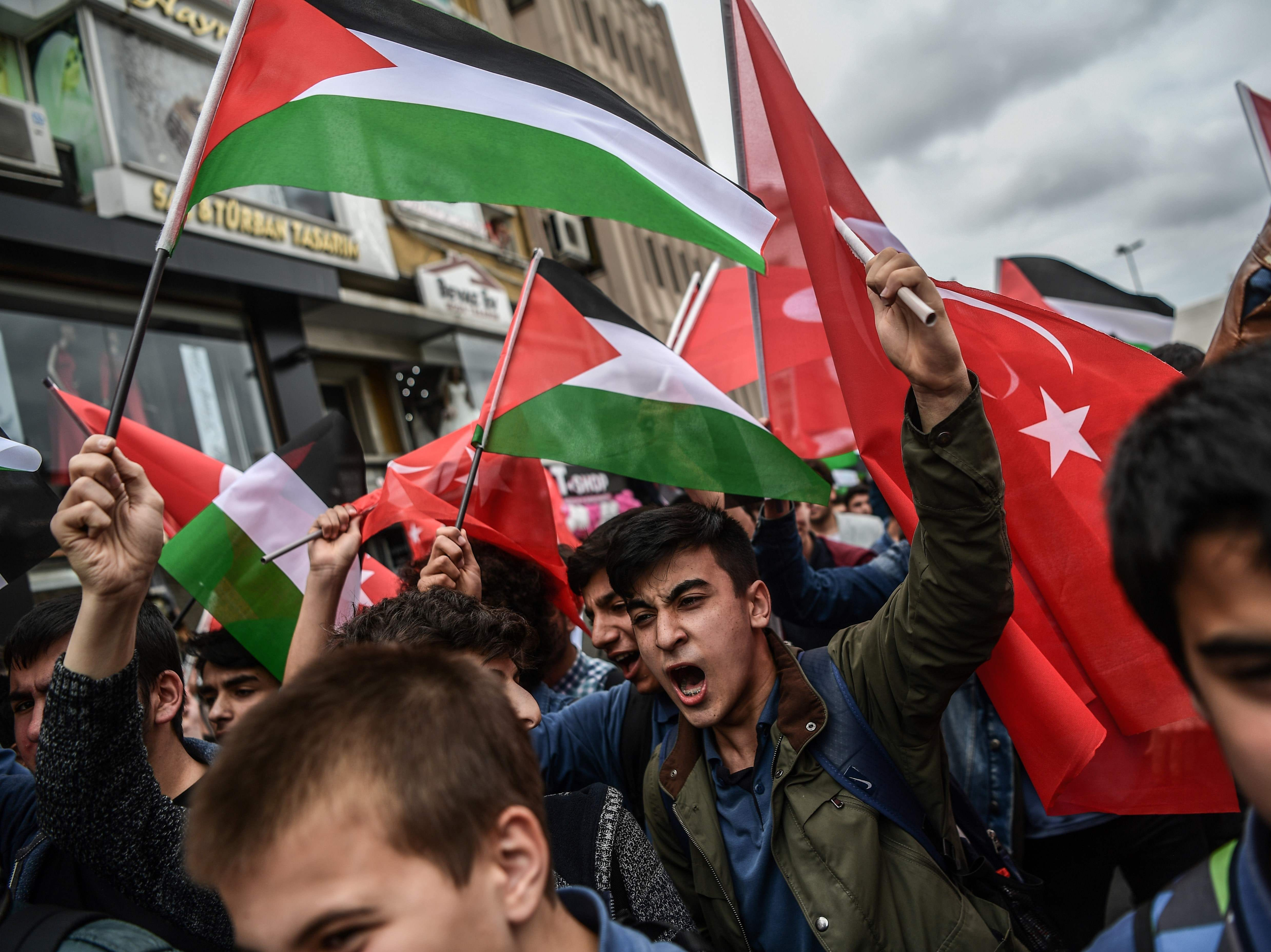 May 11, 2018: Protesters wave Turkish and Palestinian flags as they shout slogans against Israel and USA during a demonstration in Istanbul against  President Trump's controversial policy to recognize Jerusalem as Israel's capital by the opening of a US embassy in the city.  The United States is scheduled to move its embassy in Israel from Tel Aviv to Jerusalem, which has resulted in protest rallies across the world.