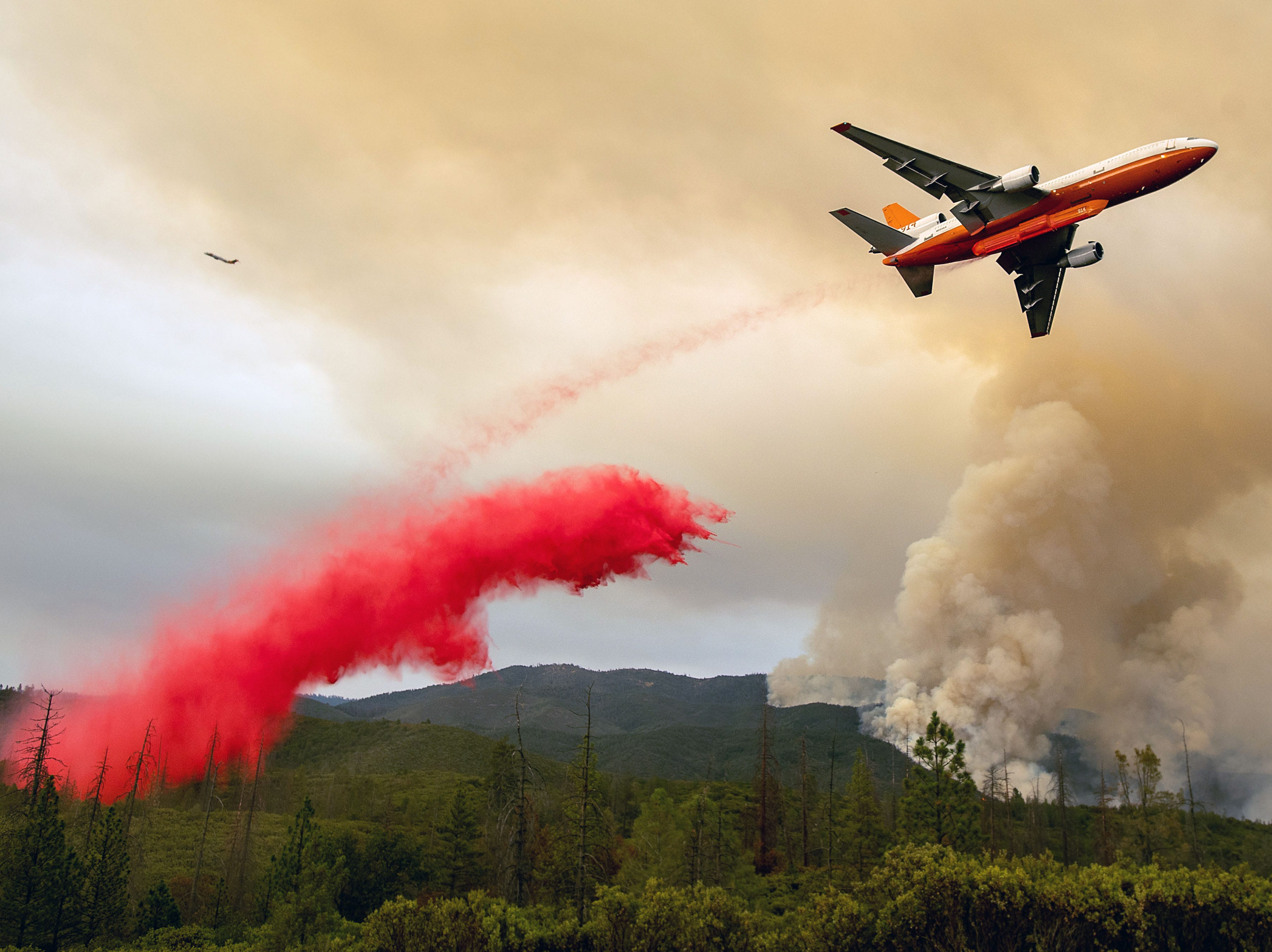 July 21, 2018: An air tanker drops retardant while battling the Ferguson fire in the Stanislaus National Forest near Yosemite National Park, California.