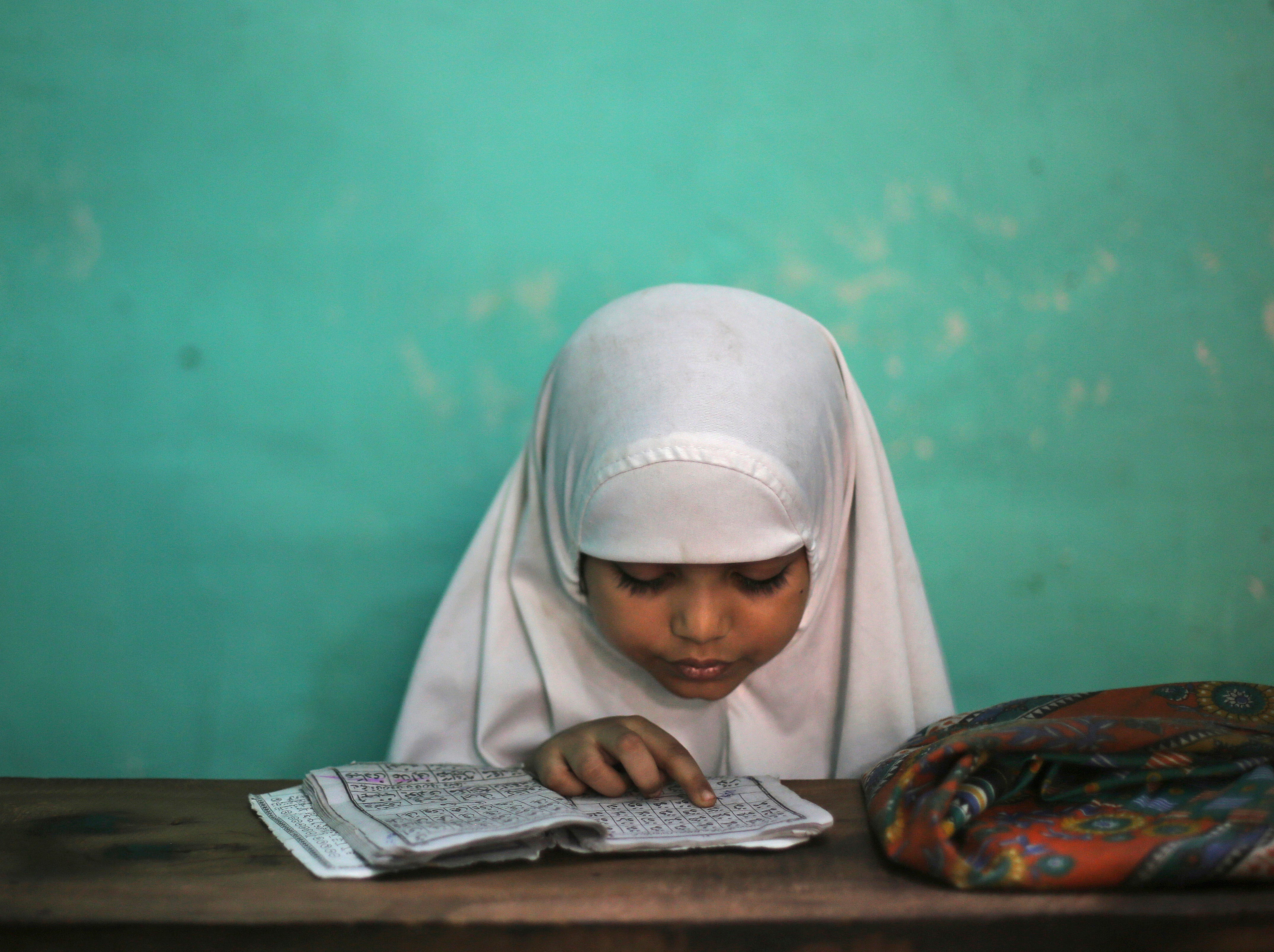 May 22, 2018: A young Indian Muslim girl learns to read the Quran at a madrasa during the holy Muslim month of Ramadan in New Delhi, India.