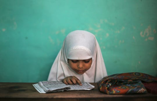 A young Muslim girl learns to read the Quran at school during Ramadan in New Delhi, India, in May 2018.