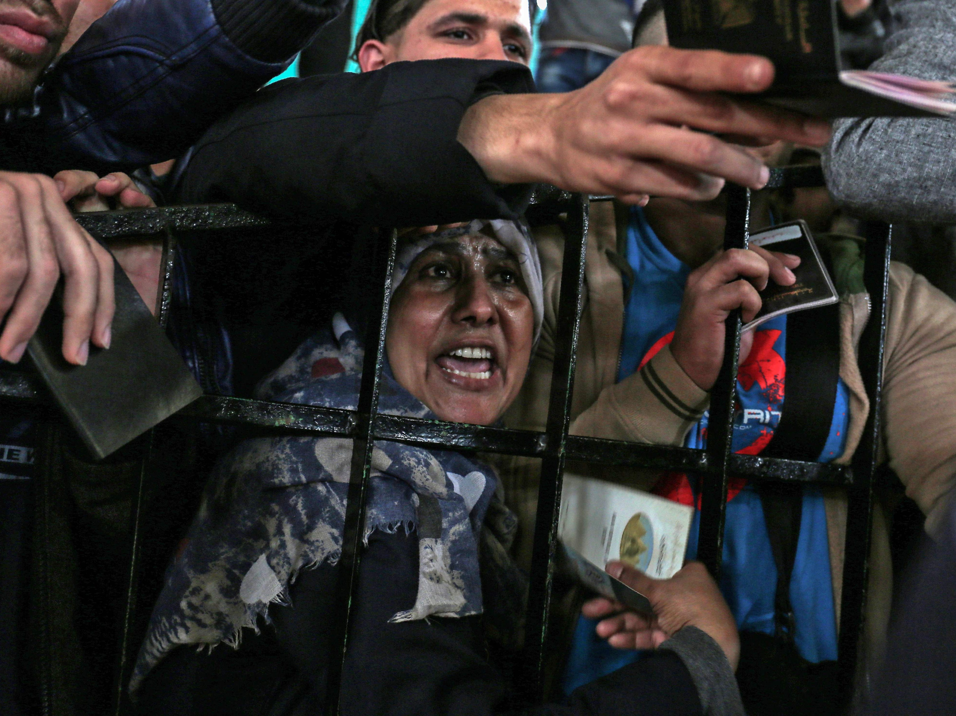 April 12, 2018: Palestinians gather at the Rafah border crossing as they wait to travel into Egypt after the passage was opened for three days for humanitarian cases, in the southern Gaza Strip.