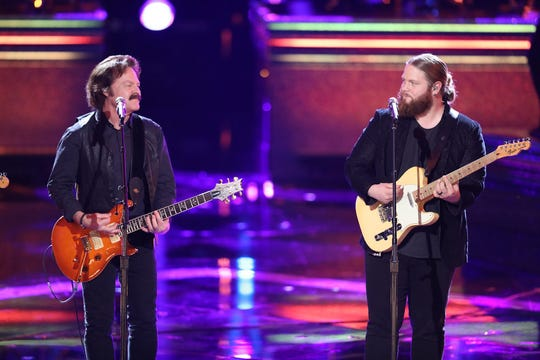Finalist Chris Kroeze, right, performs with The Doobie Brothers.
