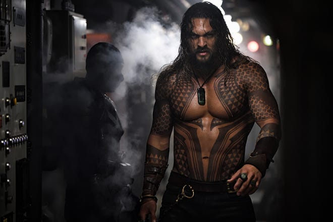 Jason Momoa is Aquaman with a touch of blue collar and a dash of rocker Slash.