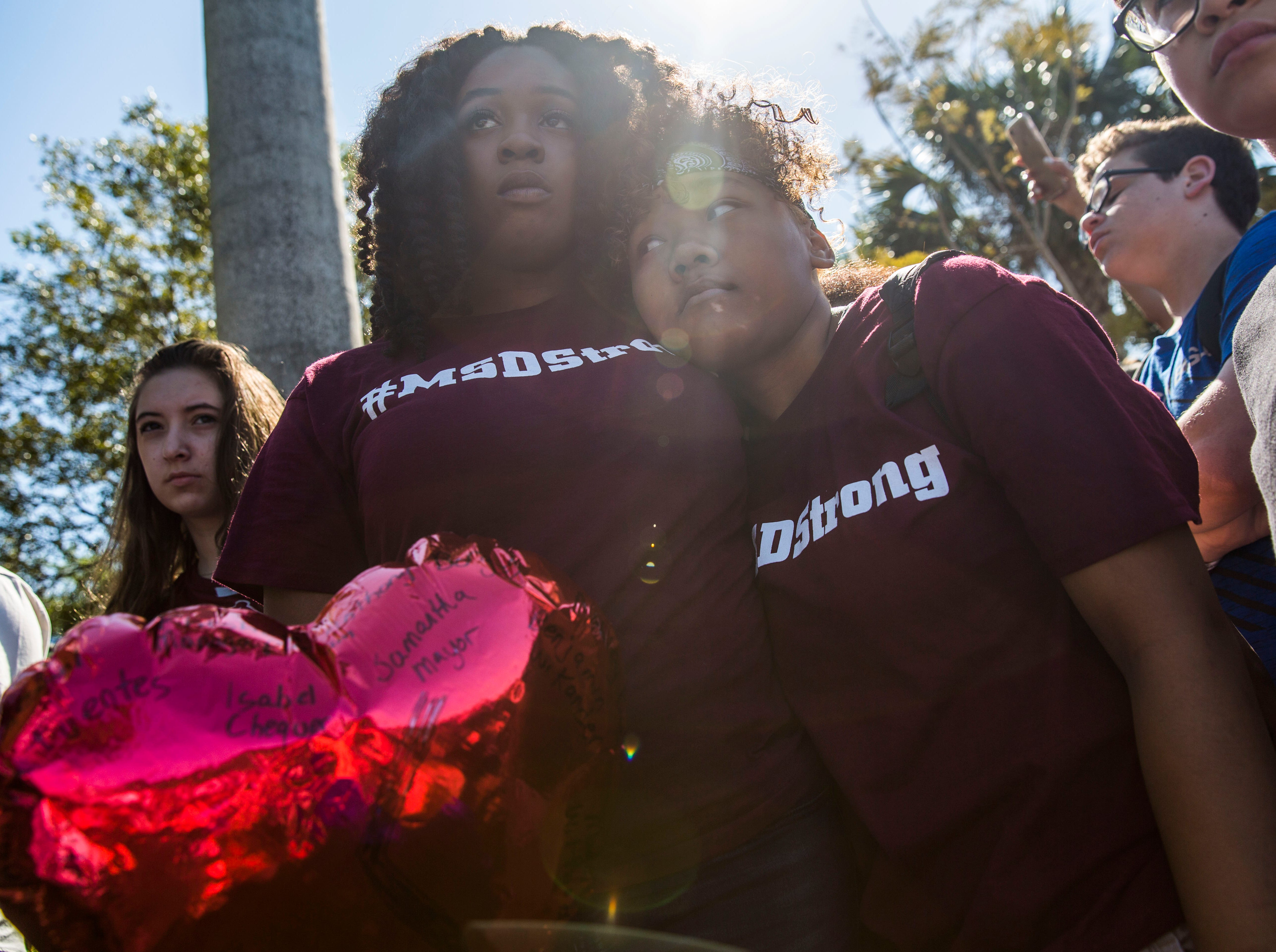 March 14, 2018: Mei-Ling Ho-Shing, left, and Erin LaVoix, right, listen to speakers at Pine Trails Park in Parkland, Fla. during the National School Walkout.