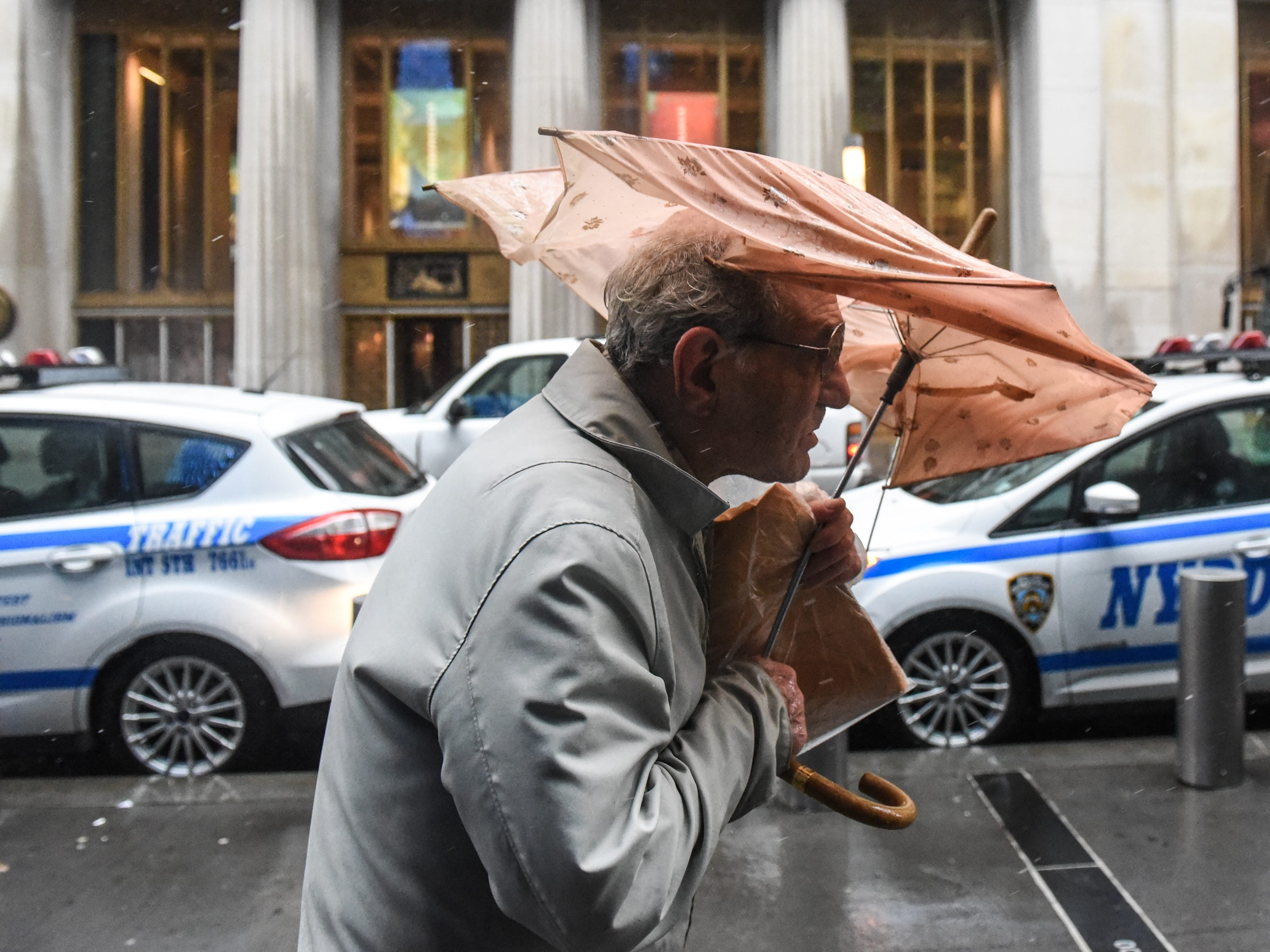 March 2, 2018: A person struggles with their umbrella during a storm in New York.