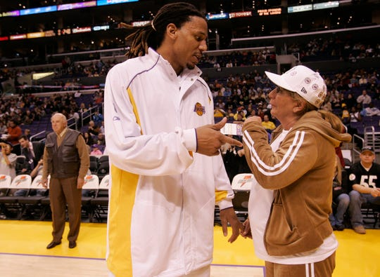 Laker Brian Grant talks to Penny Marshall during pregame warm-ups in 2005.