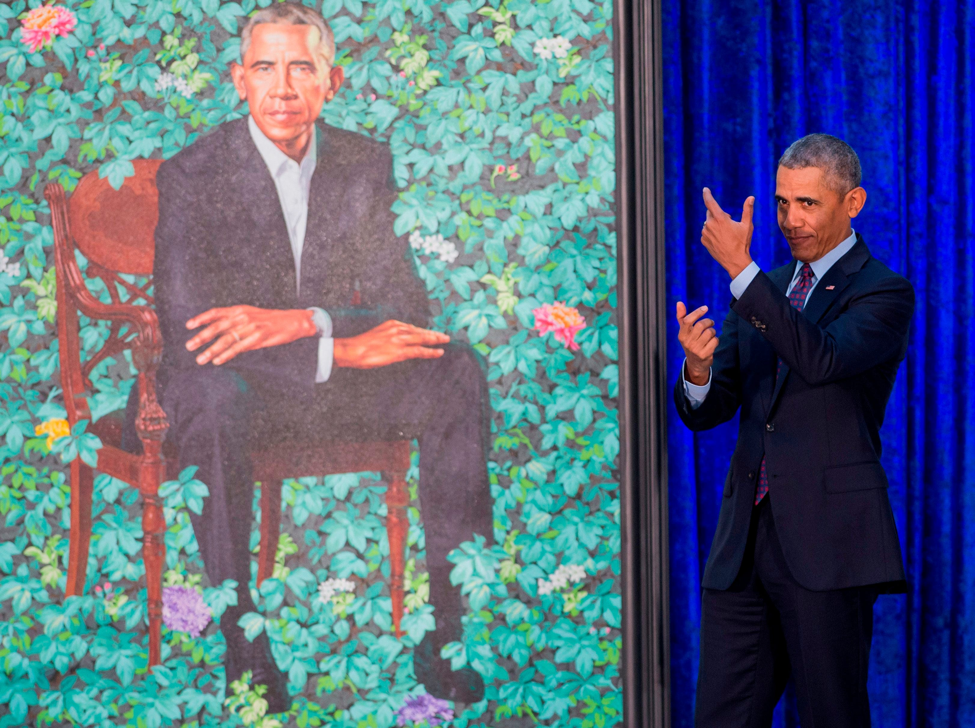 Feb. 12, 2018: Former President Barack Obama pretends to take a selfie as he looks at his portrait by artist Kehinde Wiley during the unveiling at the Smithsonian's National Portrait Gallery in Washington.