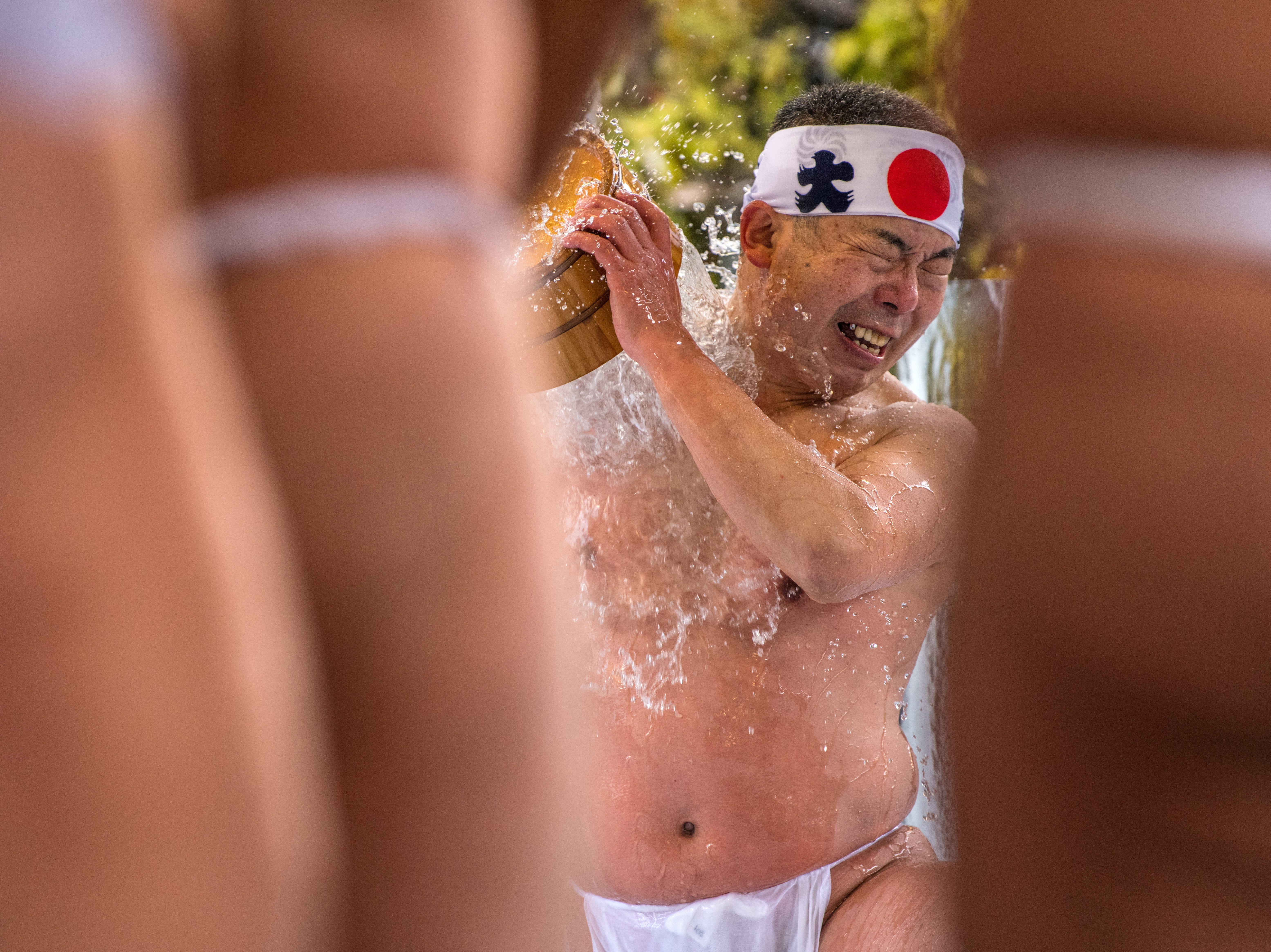 Jan. 13, 2018: A man pours ice-cold water over himself during a purification ritual at Kanda Myojin shrine in Tokyo, Japan. The coming of age purification ritual is a part of the two-day festival held annually at Kanda Myojin Shrine each January to honor and pay homage to Daikoku, the deity of fortune.