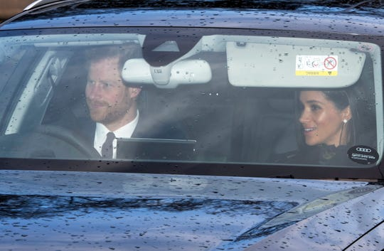 Prince Harry and Duchess Meghan arrive at the annual Christmas lunch at Buckingham Palace in London on Dec. 19, 2018.