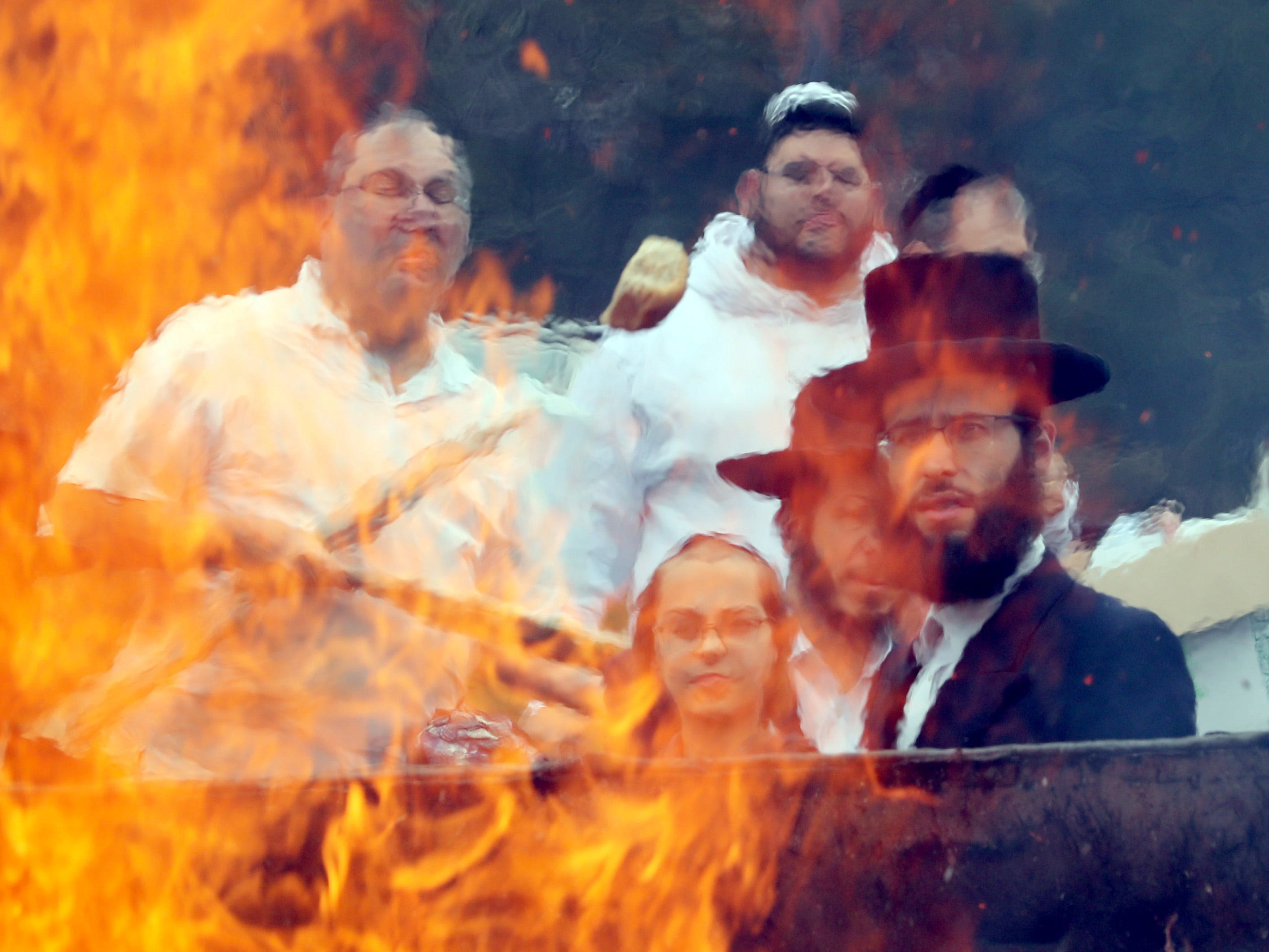 March 30, 2018: Members of the Orthodox Jewish community throw bread products into a fire at the old drive-in theater on route 59 in Spring Valley, N.Y. before the start of Passover.