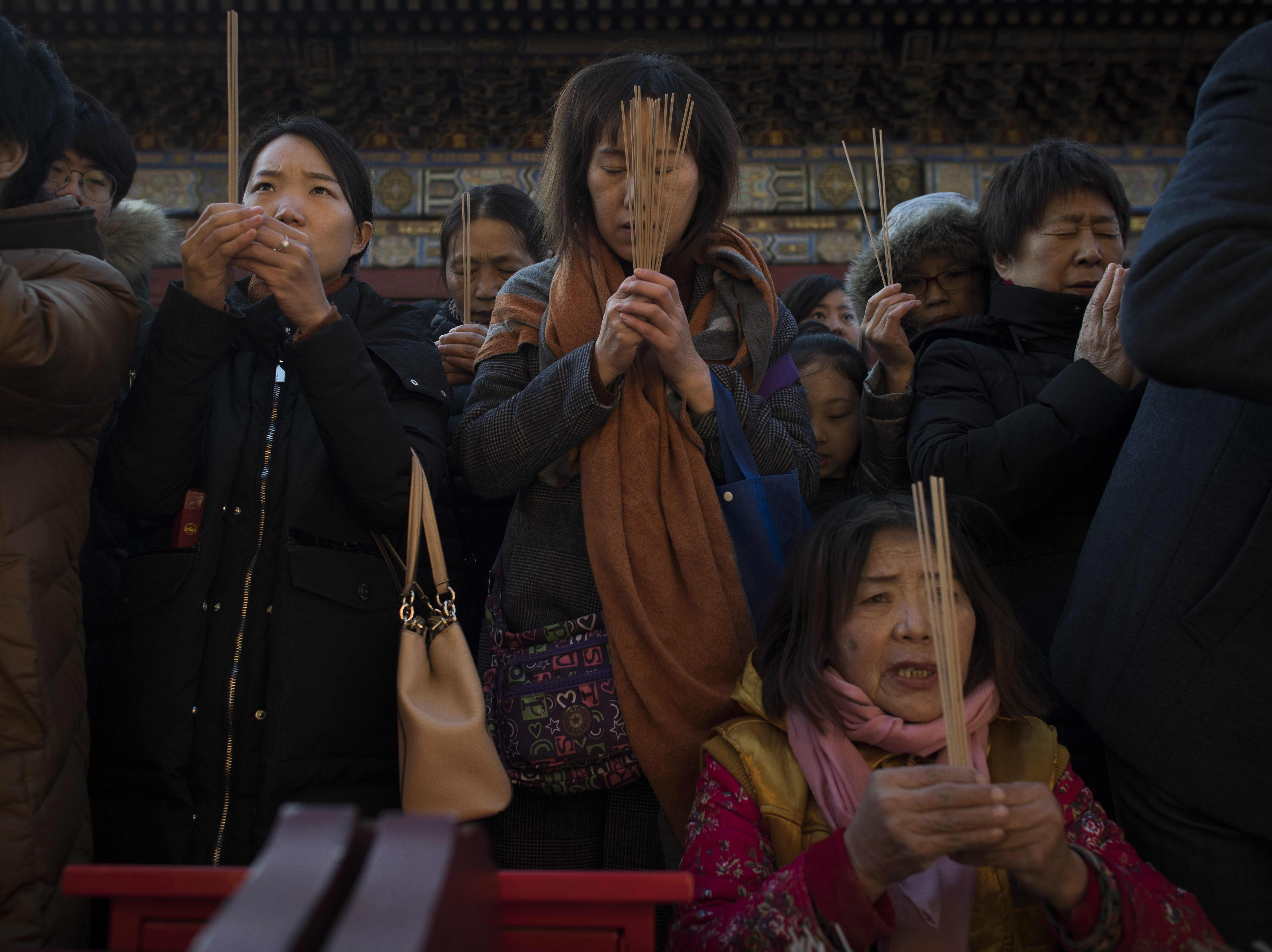 Feb. 16, 2018: People pray to celebrate the Lunar New Year, marking the Year of the Dog, at the Lama temple in Beijing.