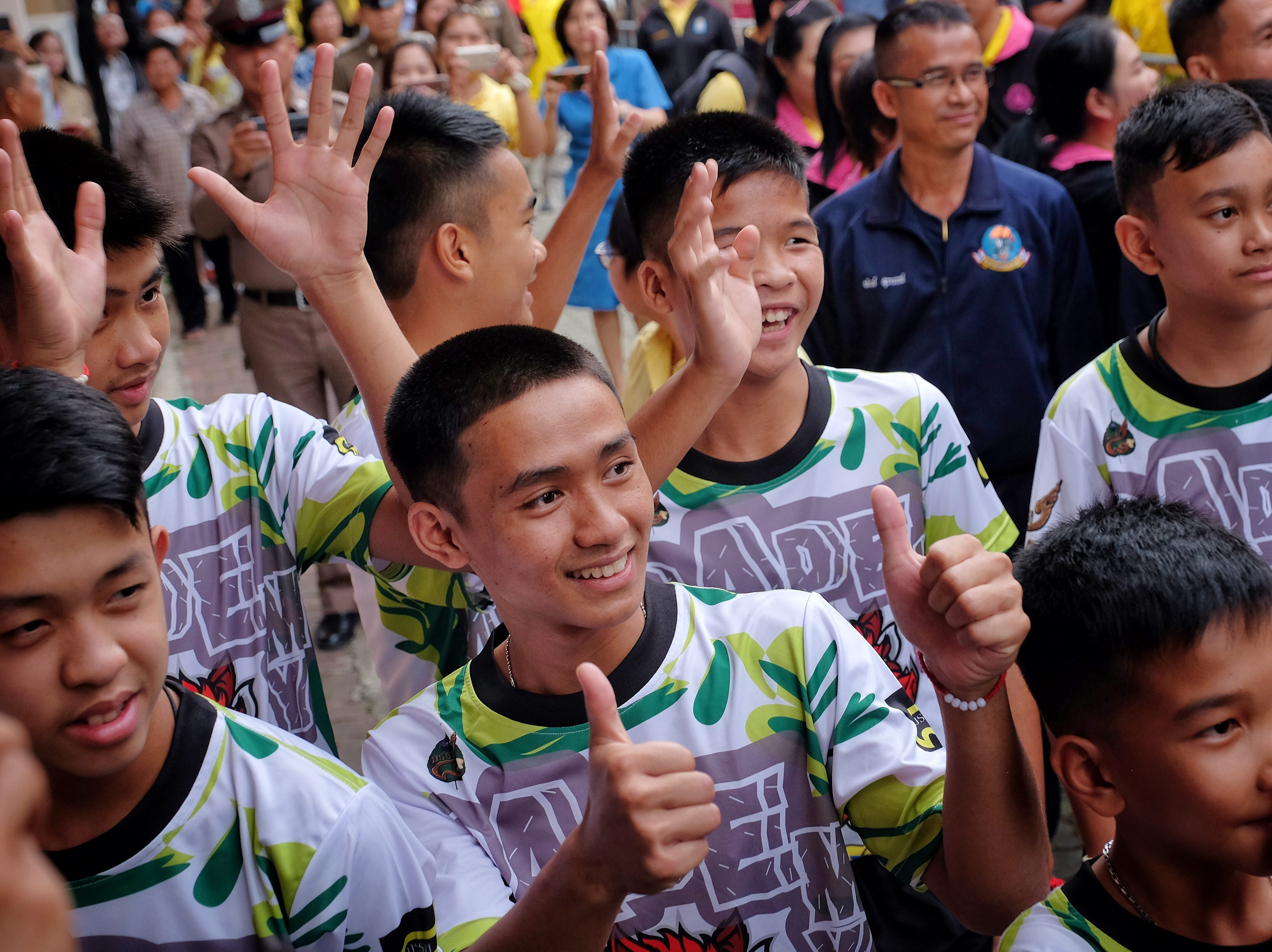 """July 18, 2018: Twelve boys and their coach from the """"Wild Boars"""" soccer team arrive for a press conference in Chiang Rai, Thailand for the first time since they were rescued from a cave in northern Thailand. The 12 boys, aged 11 to 16, and their 25-year-old coach were discharged early from Chiang Rai Prachanukroh hospital after a speedy recovery and thanked those involved in their rescue."""