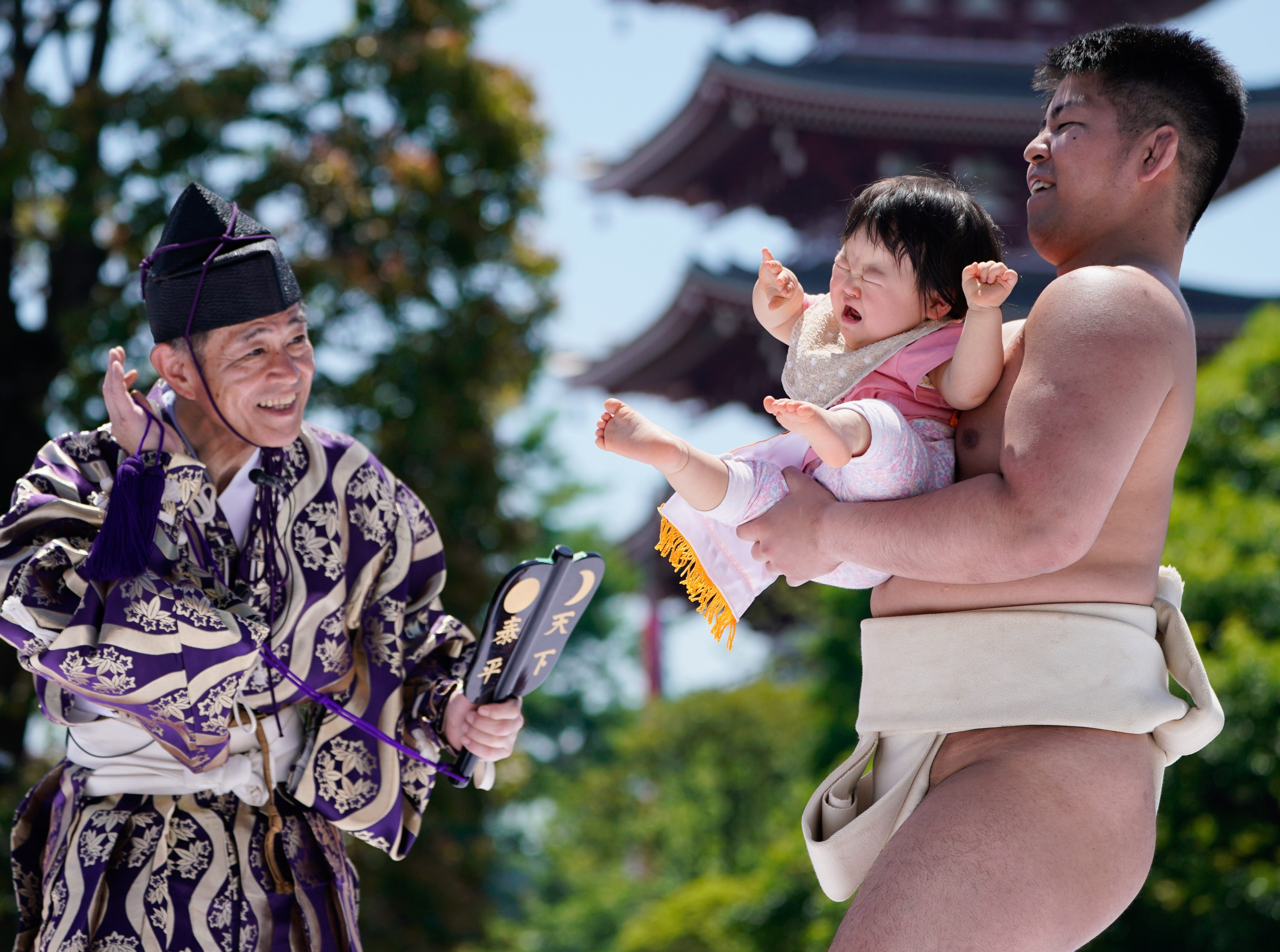 April 28, 2018: A crying baby is held by an amateur sumo wrestler during Nakizumo, a baby crying contest at Sensoji Temple in Tokyo's Asakusa district. Some 160 babies participated in the spring event, praying for their good health and growth. The baby who begins to cry first and the loudest is declared the winner.