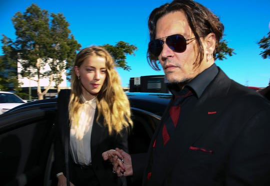 Johnny Depp and his wife Amber Heard arriving at a court in Australia in April 2016.