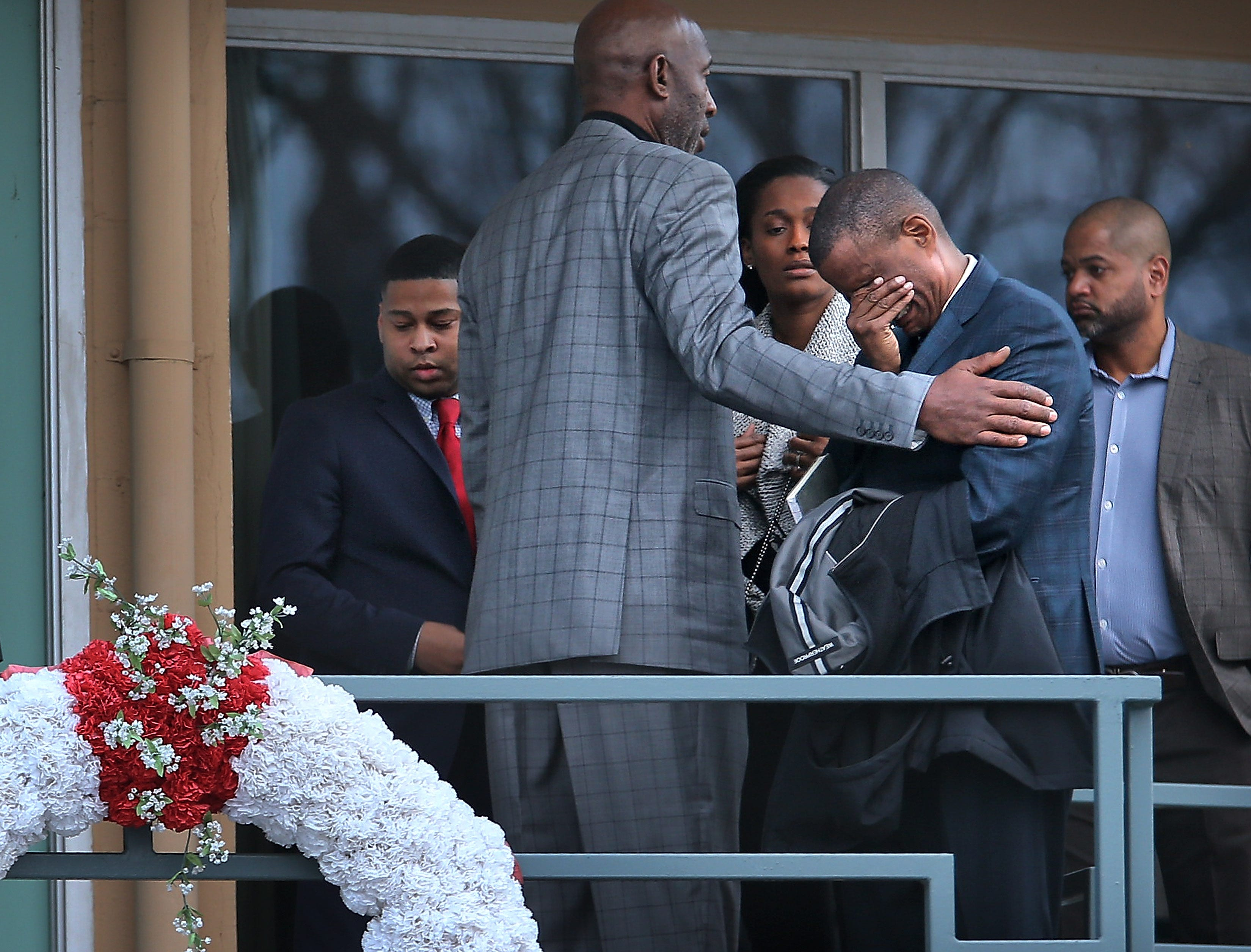 Jan. 14, 2018: Basketball analyst David Aldridge is comforted by James Worthy and Swin Cash as they walk on the Lorraine Motel balcony at the National Civil Rights Museum in Memphis.