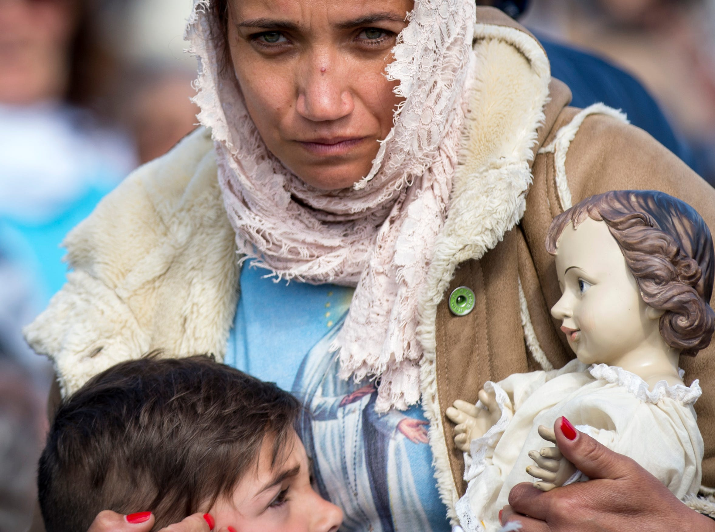 May 13, 2018: A woman and her child attend a mass ceremony at the Fatima shrine in Fatima, central Portugal. Thousands of pilgrims converged on the Fatima Sanctuary to celebrate the anniversary of Fatima's miracle when three shepherd children claimed to have seen the Virgin Mary in May 1917.