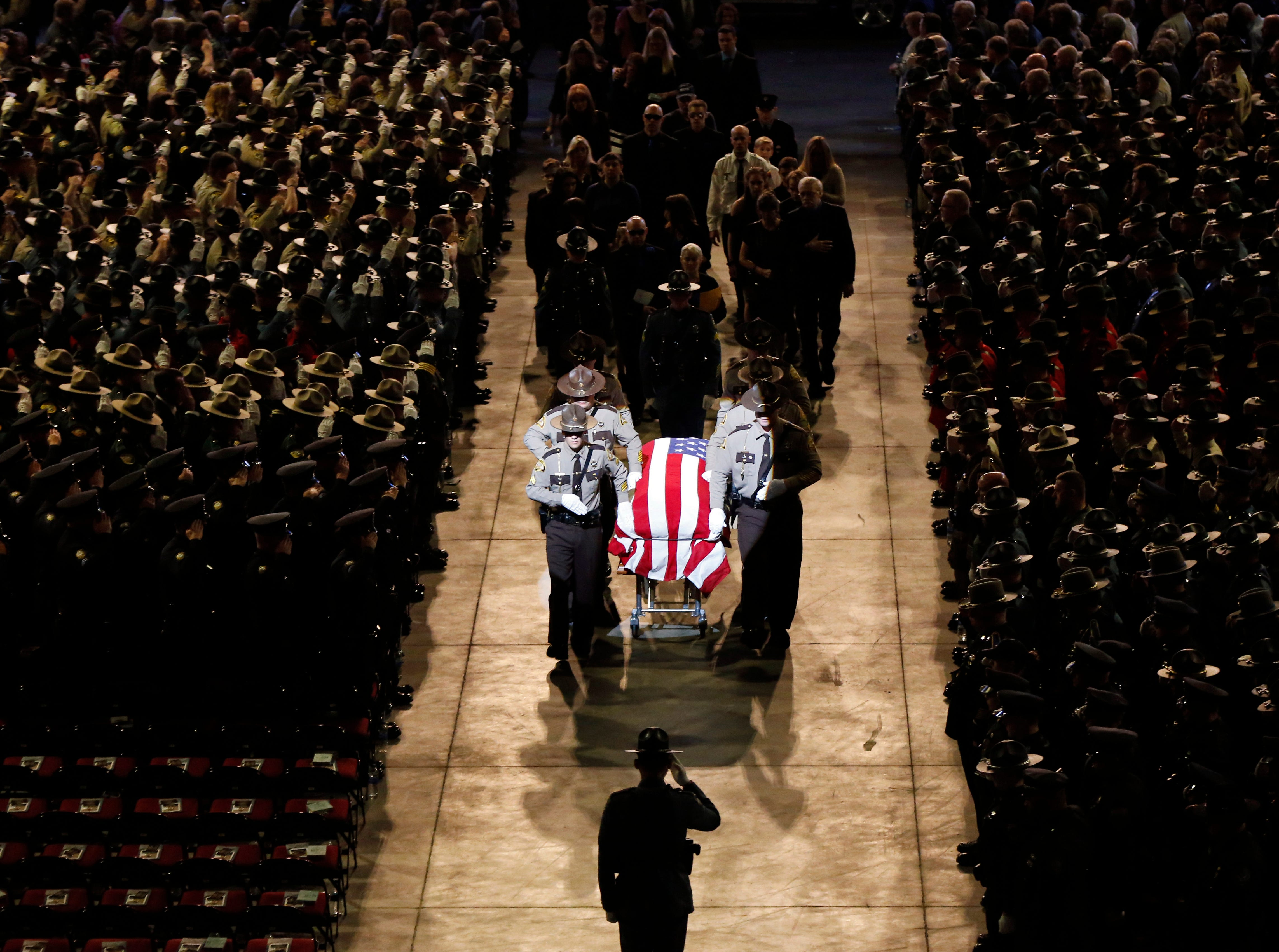 May 7, 2018: Pallbearers walk alongside the casket of Cpl. Eugene Cole at the conclusion of the funeral service at the Cross Insurance Center in Bangor, Maine. Cole, a sheriff's deputy, was the first officer to be killed in the line of duty in Maine in nearly 30 years when he was killed early on April 25 in Norridgewock.