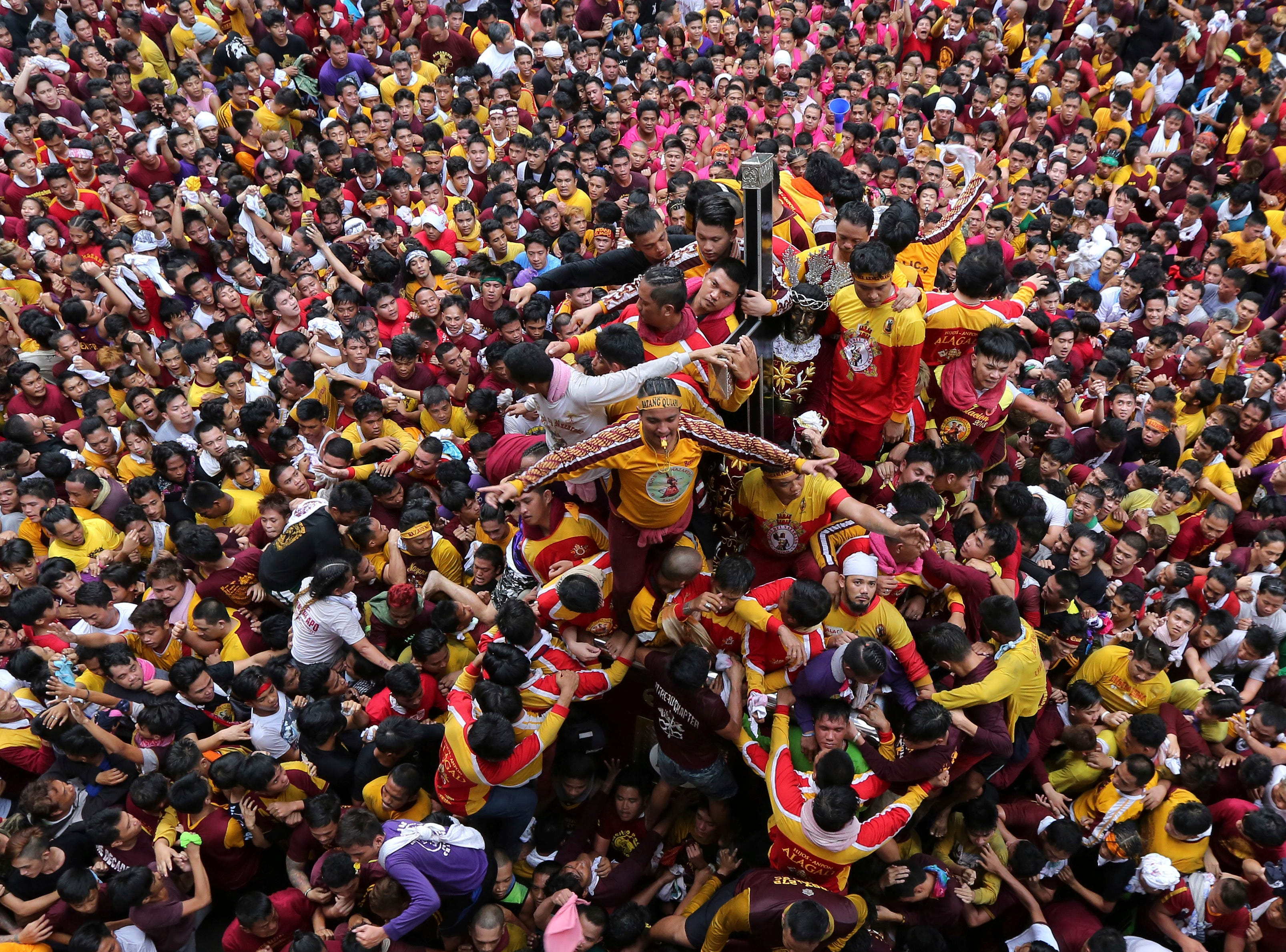 Jan. 9, 2018: Roman Catholic devotees jostle for position as they try to get near the image of the Black Nazarene during a raucous procession to celebrate it's feast day in Manila, Philippines.