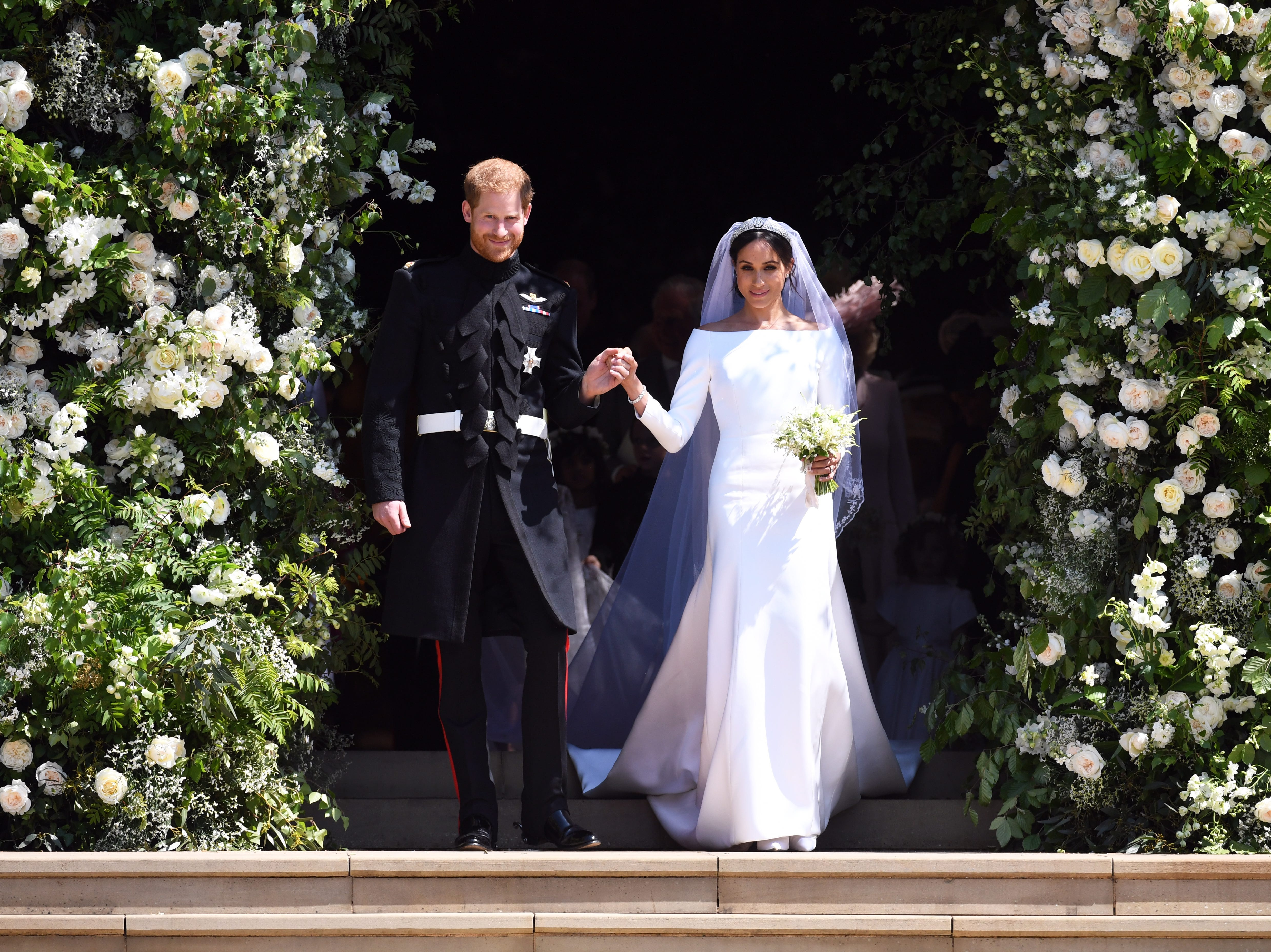 May 19, 2018: Britain's Prince Harry, Duke of Sussex and Meghan, Duchess of Sussex exit St George's Chapel in Windsor Castle after their royal wedding ceremony, in Windsor, Britain. The couple have been bestowed the royal titles of Duke and Duchess of Sussex on them by the British monarch.