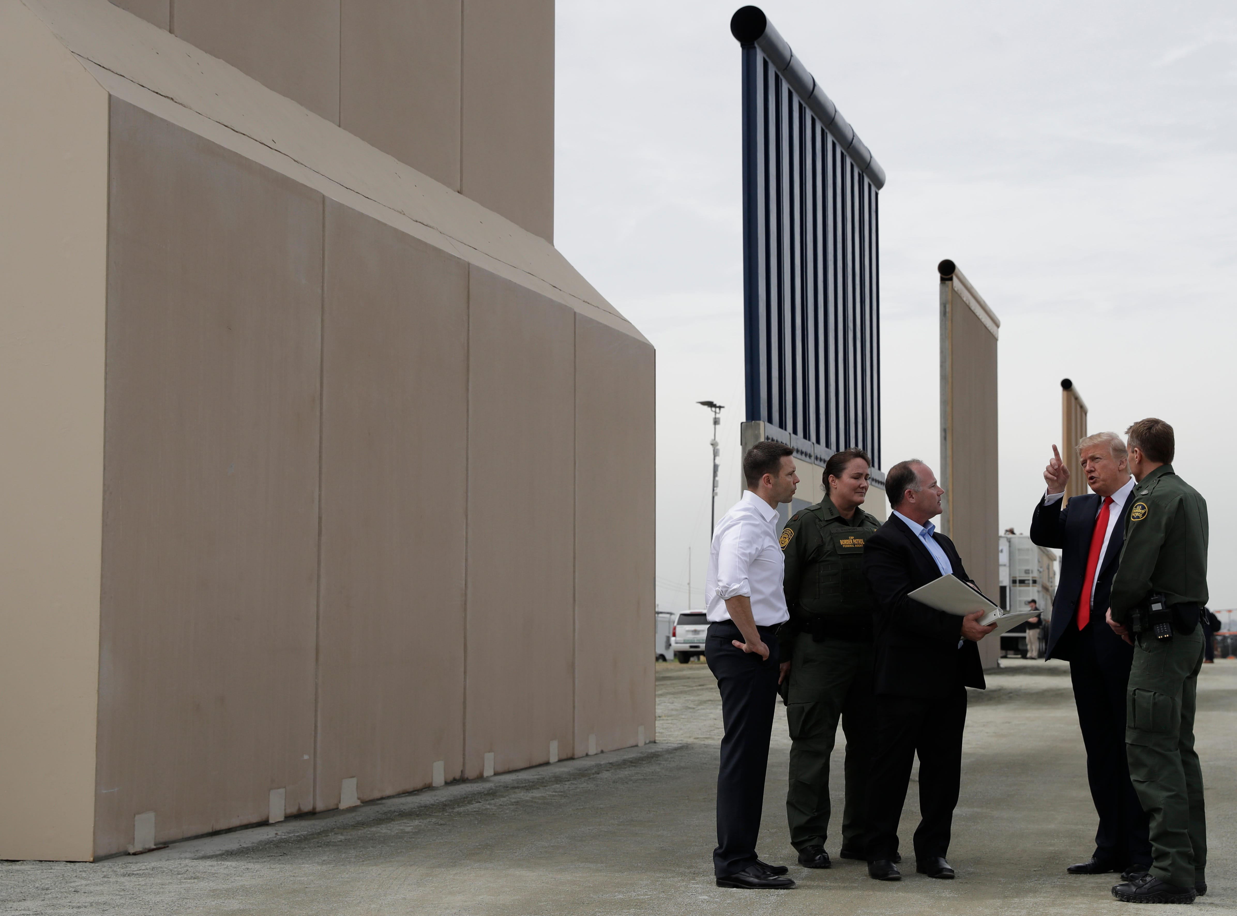 March 13, 2018: President Donald Trump speaks during a tour as he reviews border wall prototypes in San Diego.