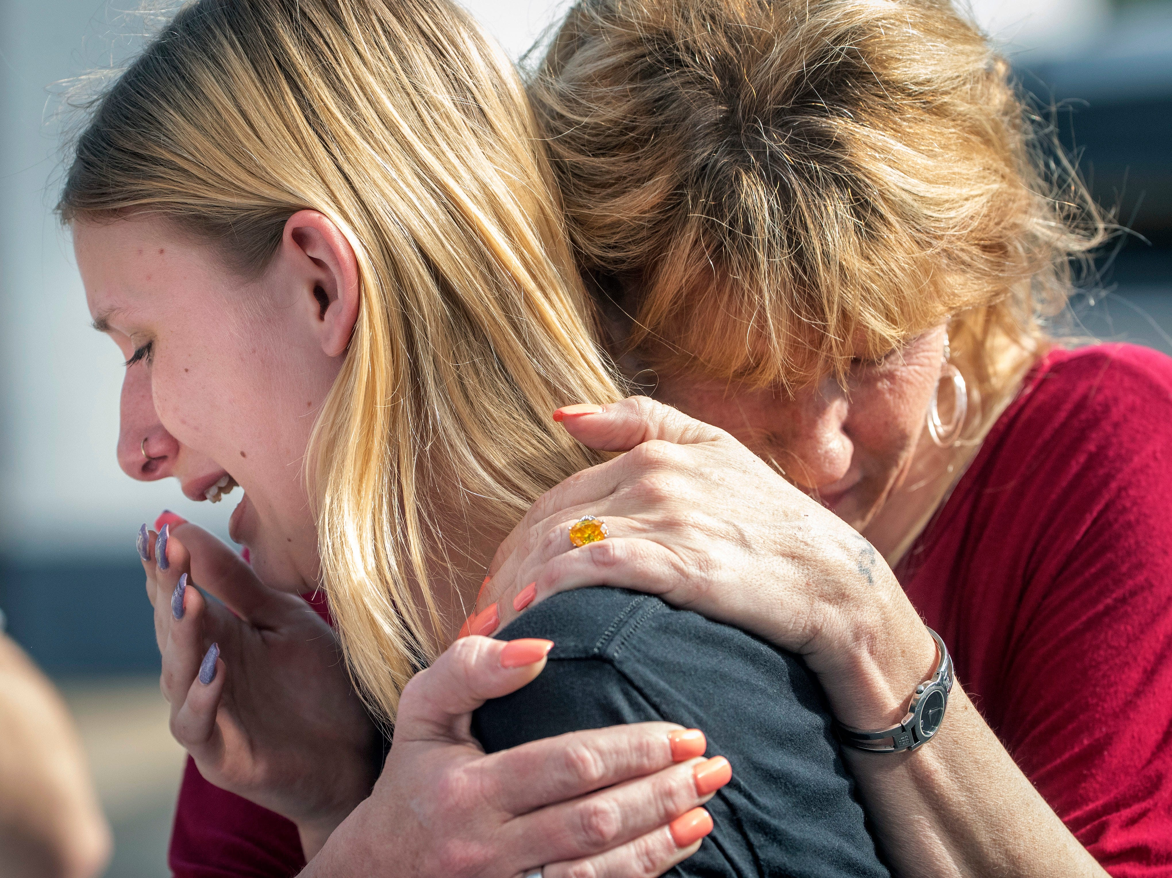 May 18, 2018: Santa Fe High School student Dakota Shrader is comforted by her mother Susan Davidson following a shooting at the school in Santa Fe, Texas. Shrader said her friend was shot in the incident.