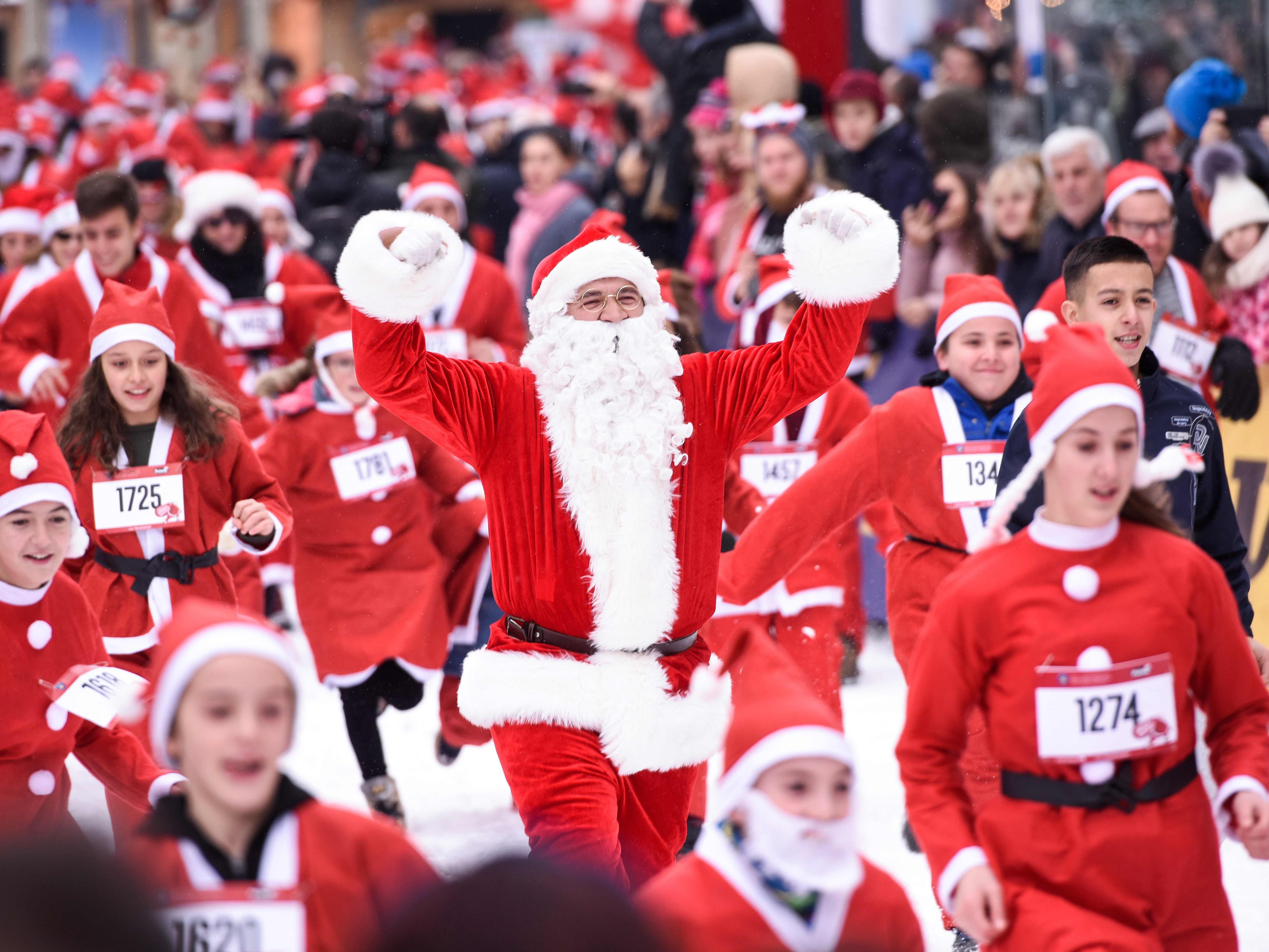 People dressed as Santa Claus take part in a charity race in Pristina, Kosovo on December 16, 2018, to raise funds for families in need in Kosovo.