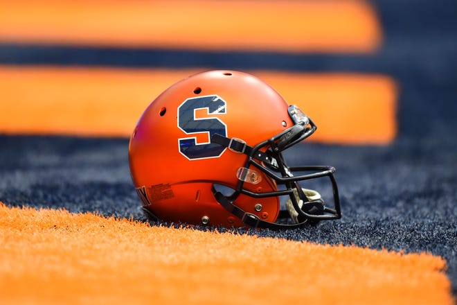 General view of a Syracuse Orange helmet on the turf prior to the game against the Central Michigan Chippewas at the Carrier Dome.