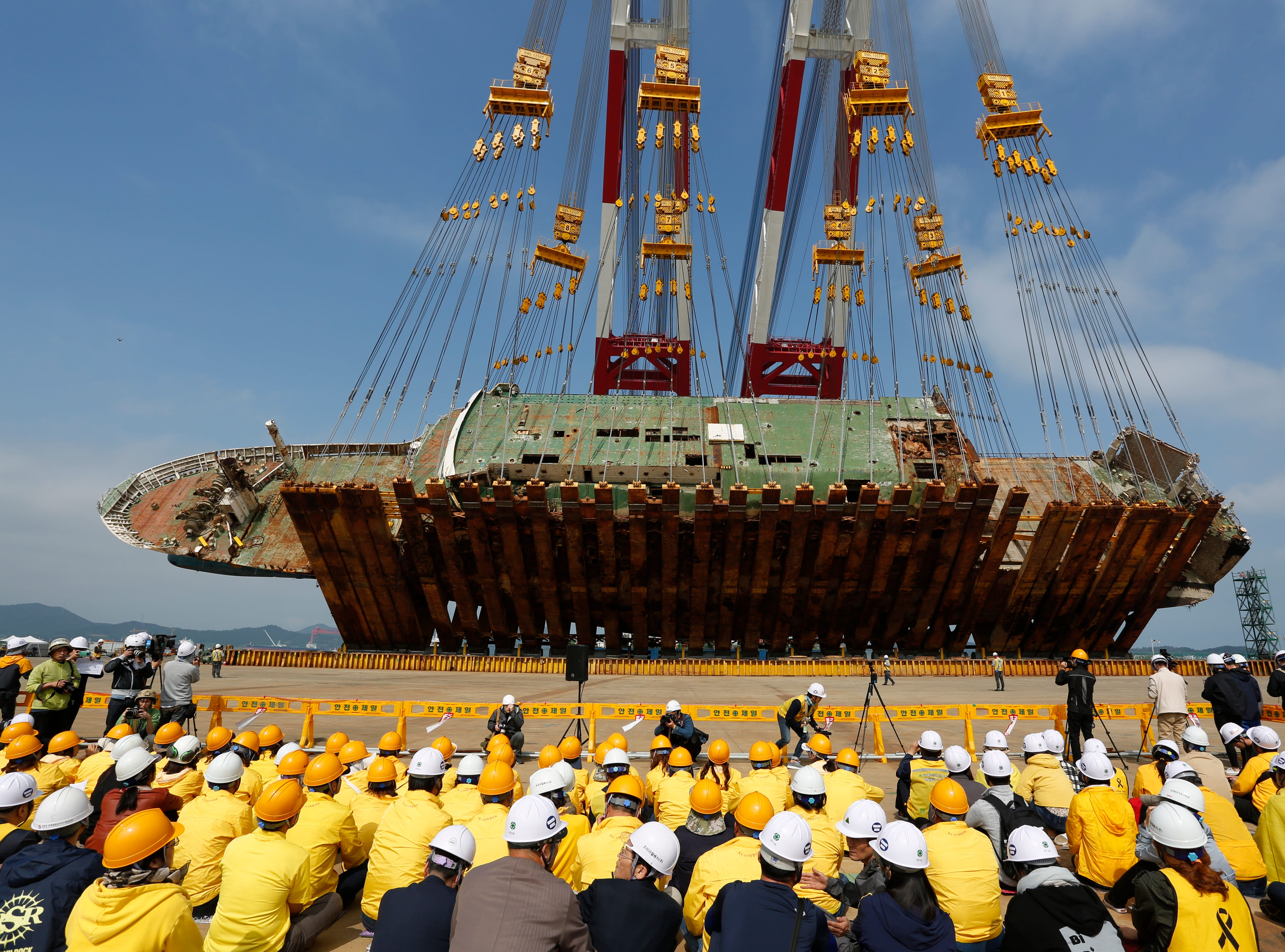 May 10, 2018: Relatives of Sewol ferry victims watch as the salvaged ferry is lifted from its side to an upright position at a port in Mokpo, 410 kilometers southwest of Seoul, South Korea. The ferry sunk off the southwestern coast on April 16, 2014, killing 304 people onboard, most of them high school students on an excursion. An investigation into the tragedy is still ongoing.