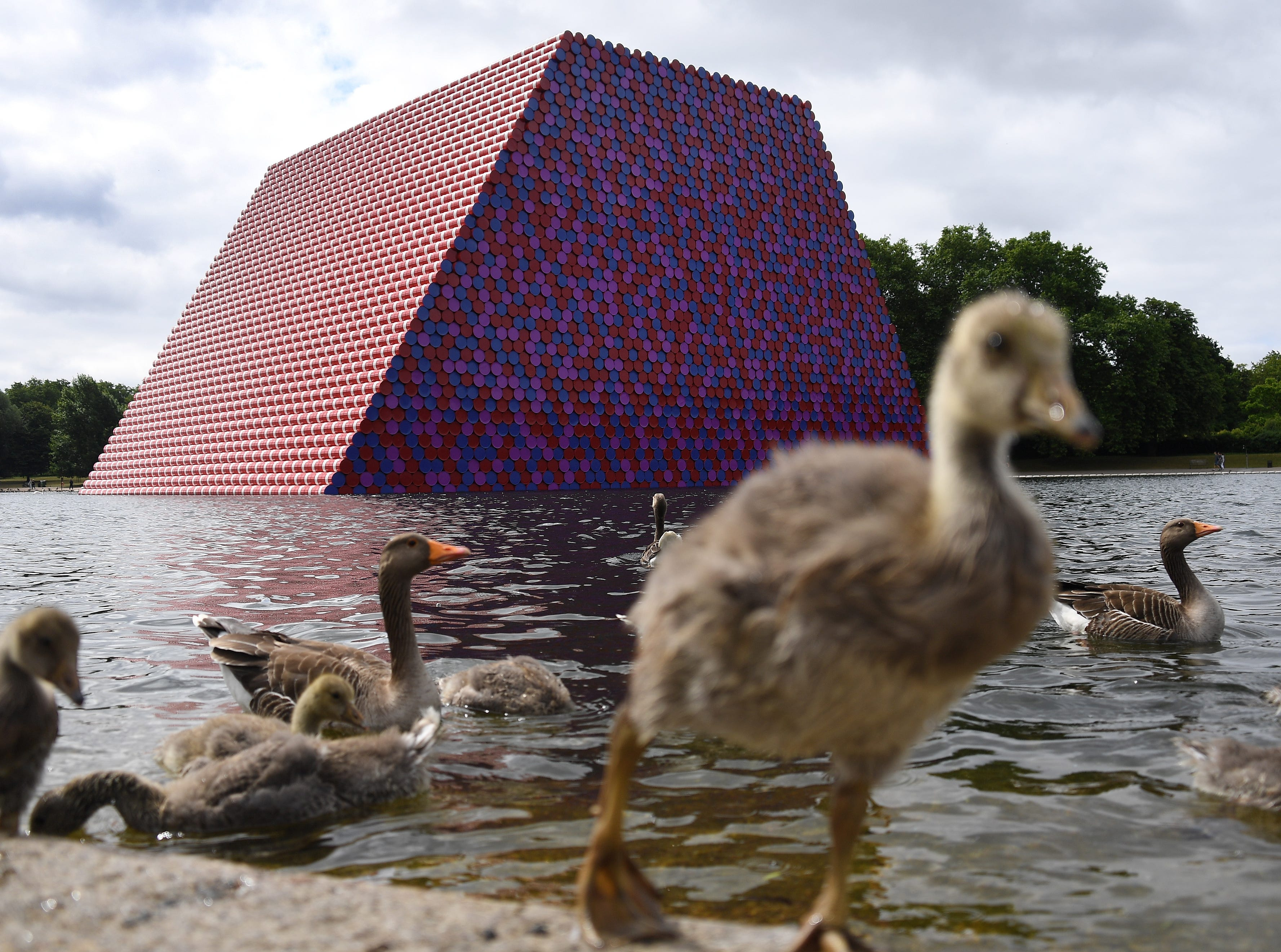 June 18, 2018: A view of the artwork 'Mastaba' by Bulgarian artist Christo, built on The Serpentine lake in London, Britain. Christo has unveiled his enormous floating structure in Hyde Park, which reaches more than 65 feet in height and is made from 7,506 horizontally stacked barrels. It is Christo's first major public outdoor work in Britain.