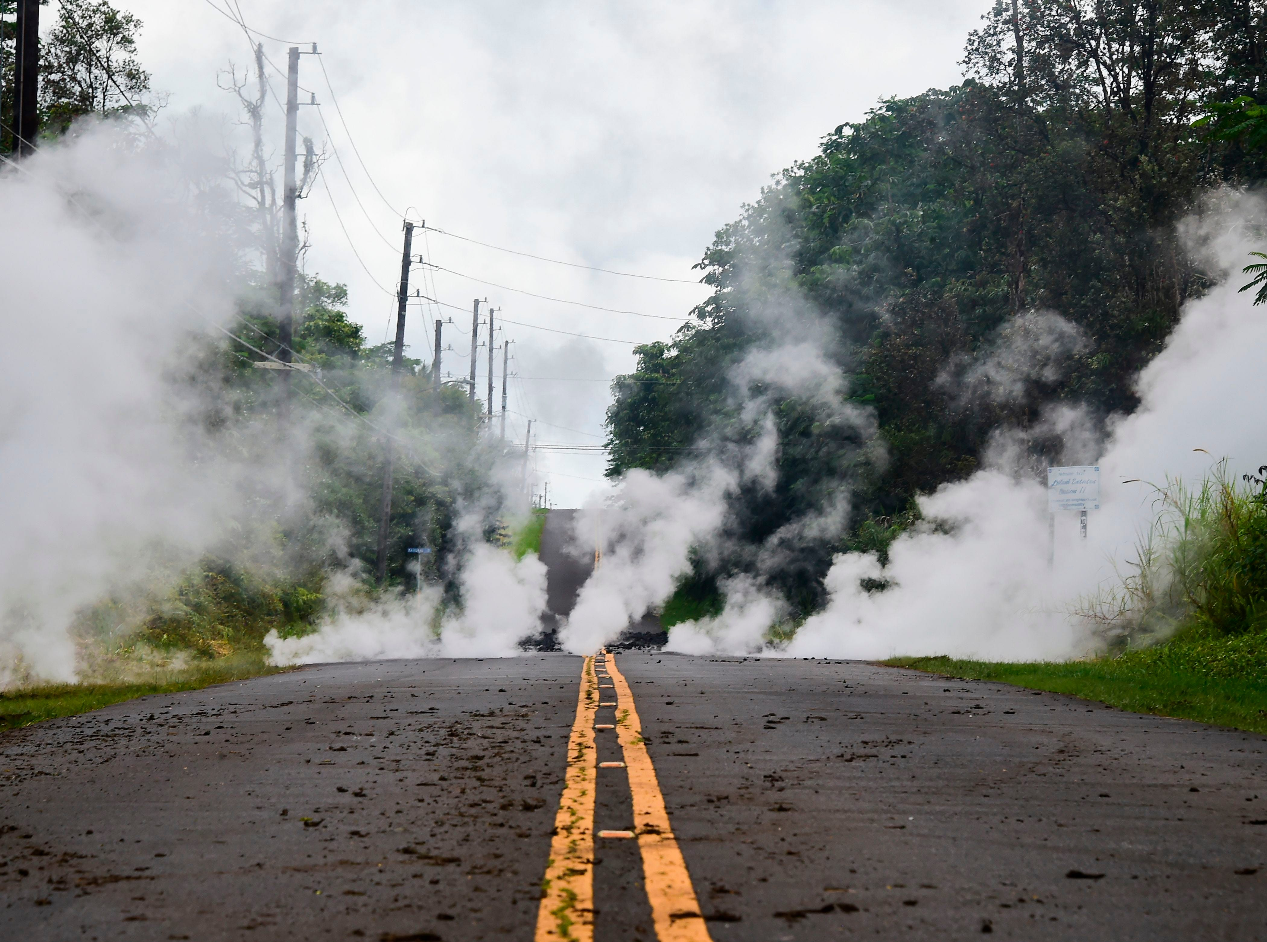 May 4, 2018: Steam rises from a fissure on a road in Leilani Estates subdivision on Hawaii's Big Island. Up to 10,000 people have been asked to leave their homes on Hawaii's Big Island following the eruption of the Kilauea volcano that came after a series of recent earthquakes.