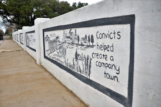 A painting on a bridge in Sugar Land notes the contribution of convicts, but doesn't mention the forced labor of African Americans in the convict leasing system.
