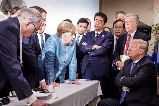 June 9, 2018: Photo released on Twitter by the German Governments spokesman Steffen Seibert and taken by the German government's photographer Jesco Denzel shows President Donald Trump talking with German Chancellor Angela Merkel (C) and surrounded by other G7 leaders during a meeting of the G7 Summit in La Malbaie, Quebec, Canada. The photo went viral, popping up all over social media, sometimes in its original form sometimes altered for humorous or satirical ends.