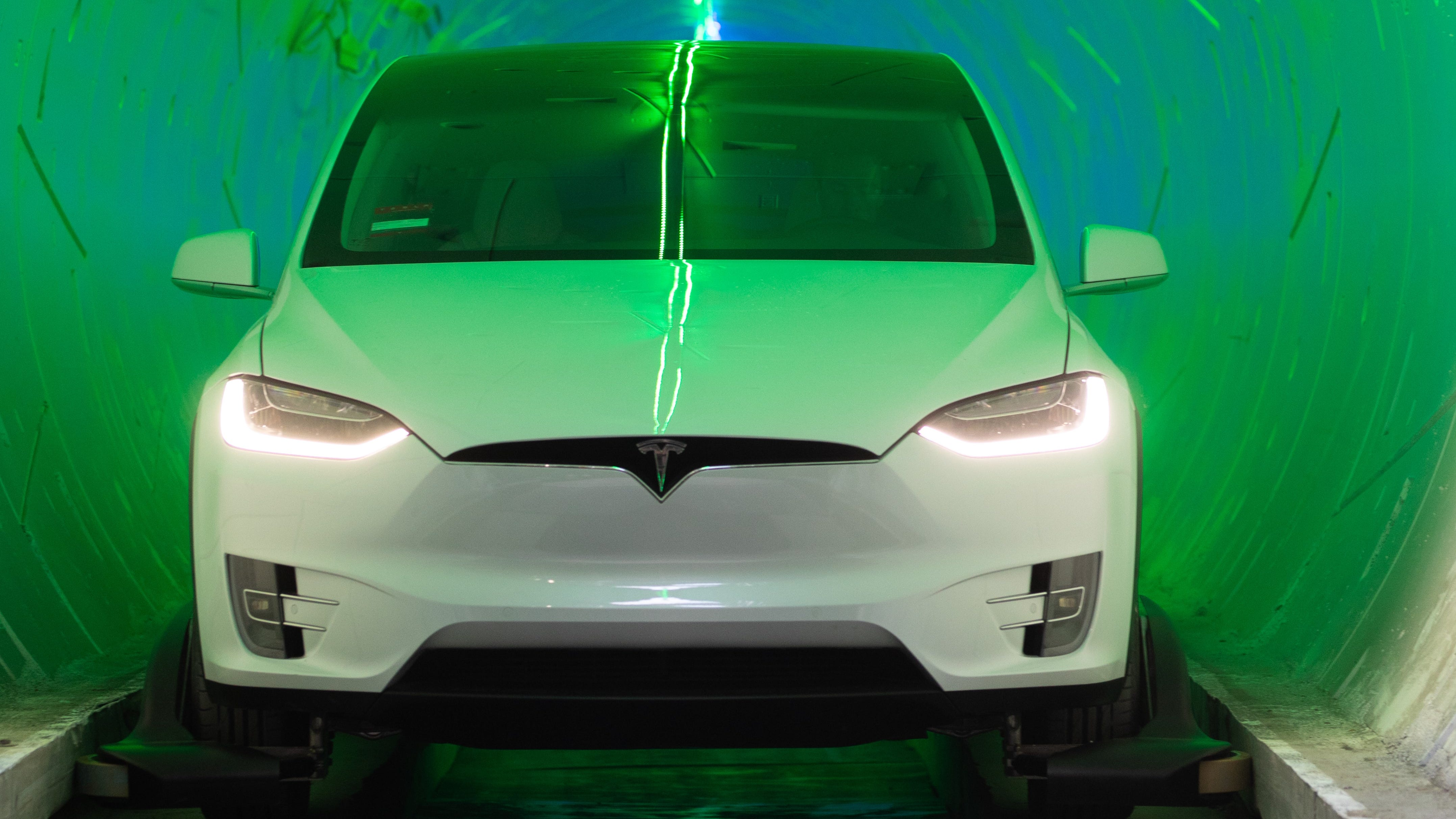 A Tesla Model X SUV in the Boring Co. tunnel in Hawthorne, California. Note the guidewheels to keep it on track