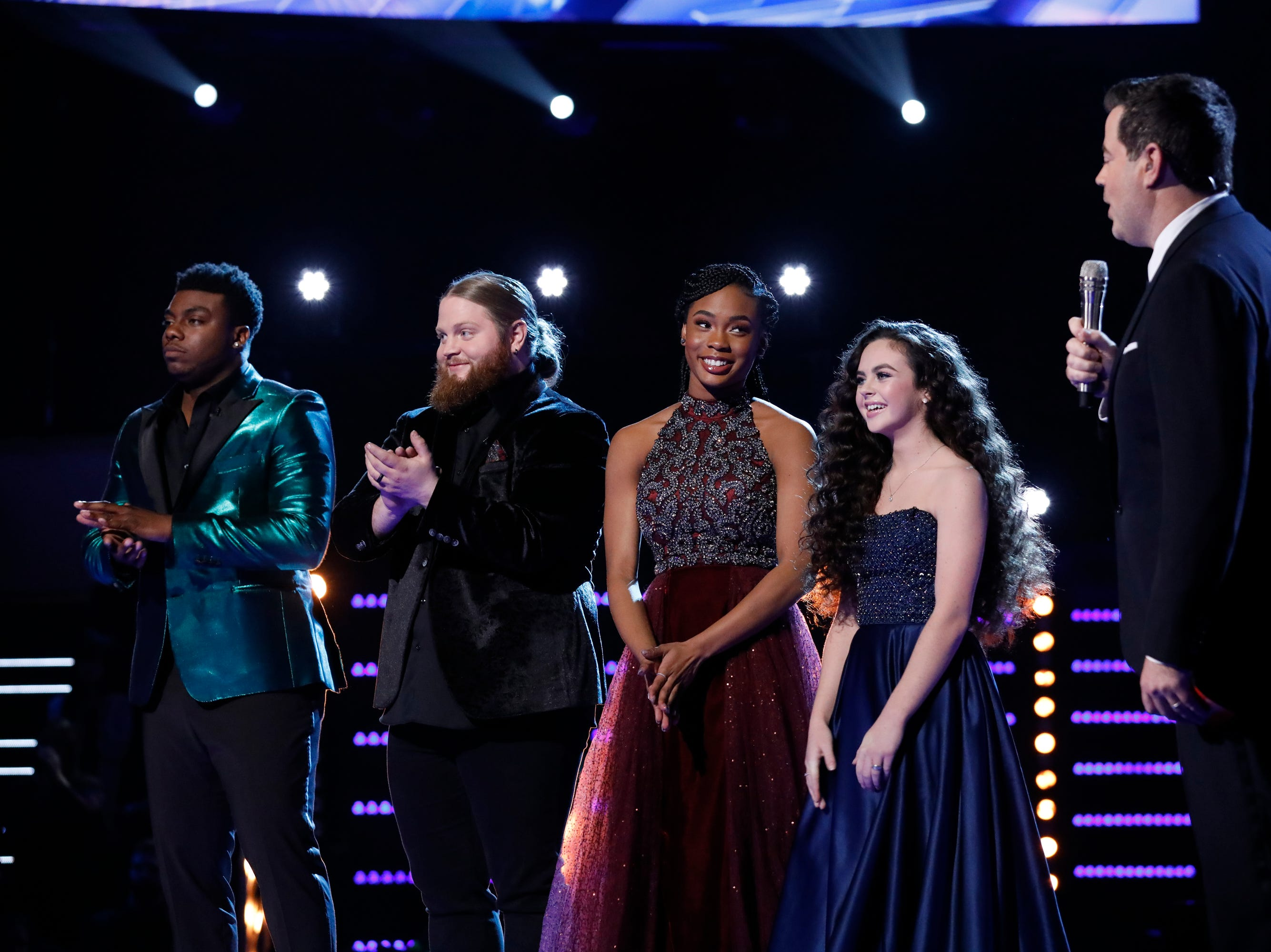 """Tension mounted Tuesday as Season 15 finalists Kirk Jay, left, Chris Kroeze, Kennedy Homes and Chevel Shepherd waited for host Carson Daly to announce the winner of """"The Voice."""""""