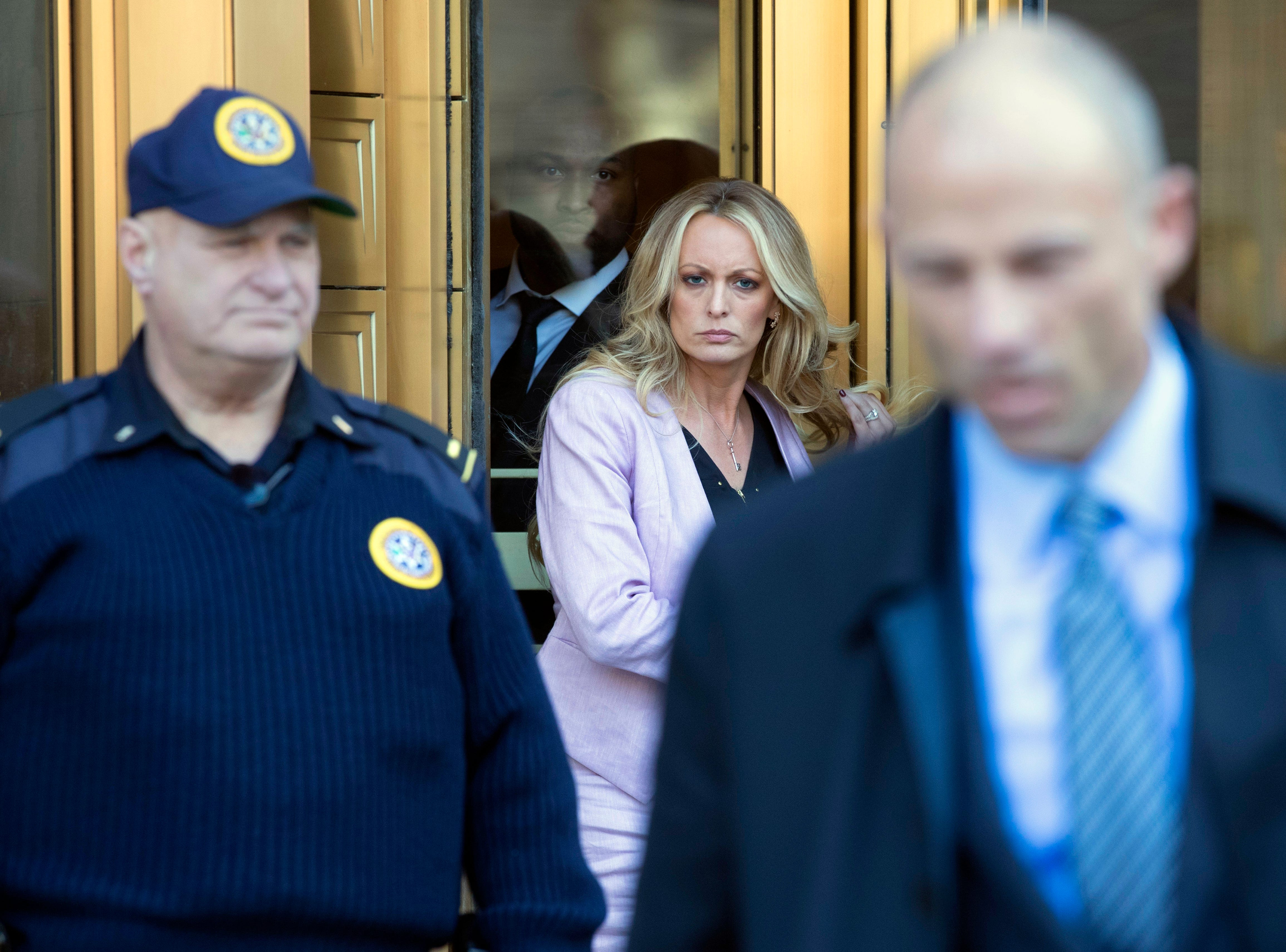 April 16, 2018: Adult film actress Stormy Daniels, center, follows her attorney Michael Avenatti, right, as she leaves federal court in New York.  A U.S. judge listened to more arguments about President Donald Trump's extraordinary request that he be allowed to review records seized from his lawyer, Michael Cohen, office as part of a criminal investigation before they are examined by prosecutors. The raid at Cohen's apartment, hotel room, office and safety deposit box sought bank records, records on Cohen's dealing in the taxi industry, Cohen's communications with the Trump campaign and information on payments made in 2016 to former Playboy model Karen McDougal and to Daniels.