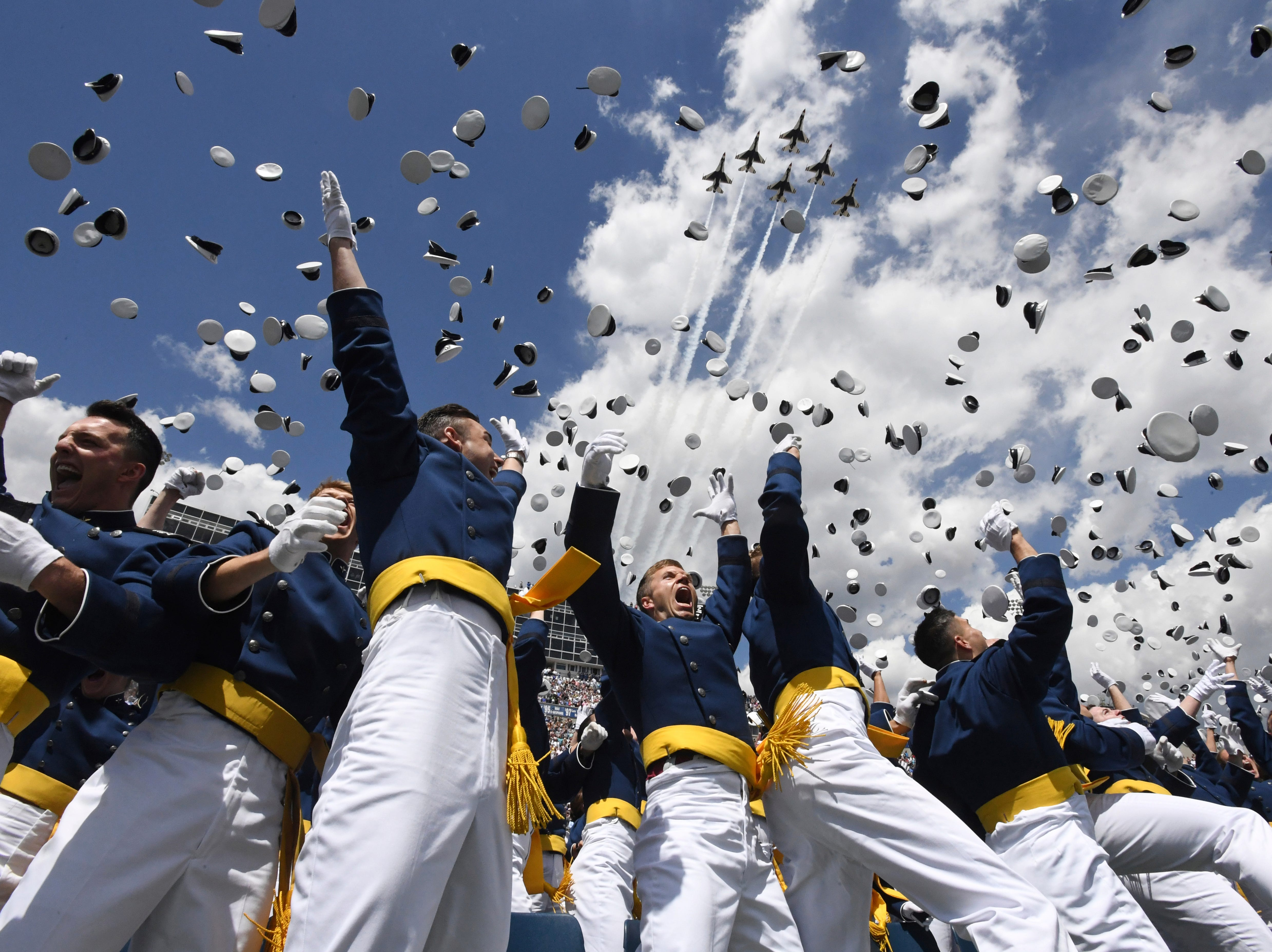 May 23, 2018: U.S. Air Force Academy cadets toss their hats in the air as the Thunderbirds fly overhead during the cadets' graduation ceremony in Colorado Springs, Colo.