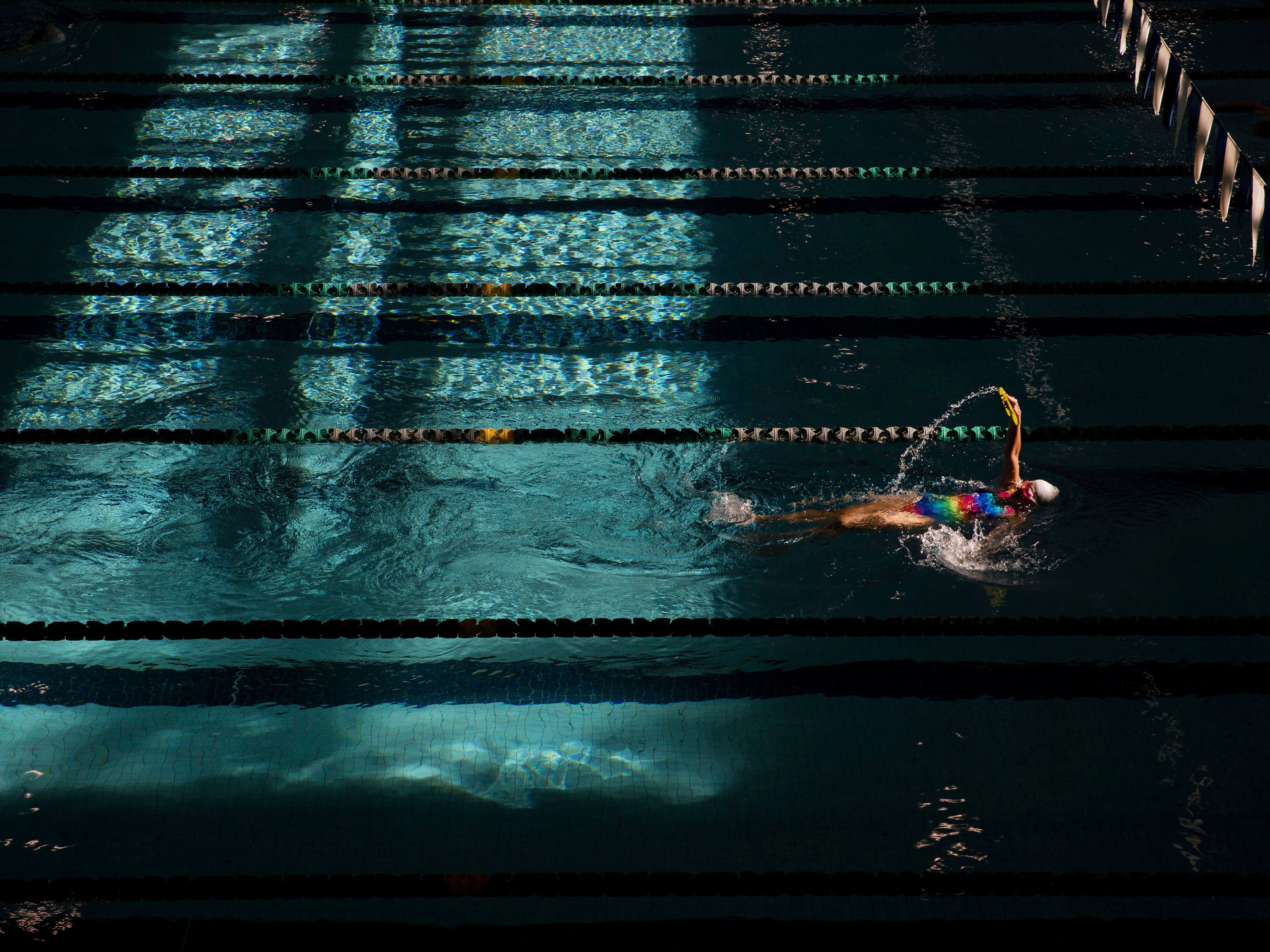 Feb. 5, 2018: Sunlight plays off the water inside Willamalane Park Swim Center as a swimmer does laps at the facility in Springfield, Ore.