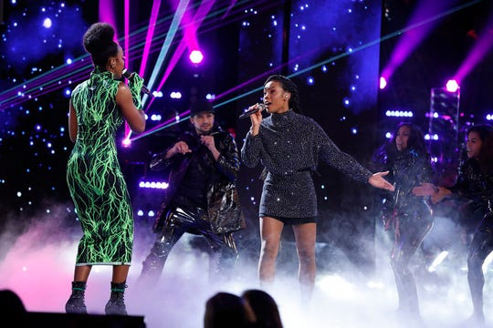 Finalist Kennedy Holmes, right, performs with Kelly Rowland.